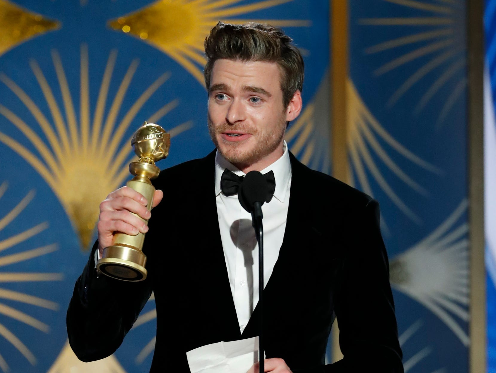 "This image released by NBC shows Richard Madden accepting the award for best actor in a TV drama series for his role in ""Bodyguard"" during the 76th Annual Golden Globe Awards at the Beverly Hilton Hotel."