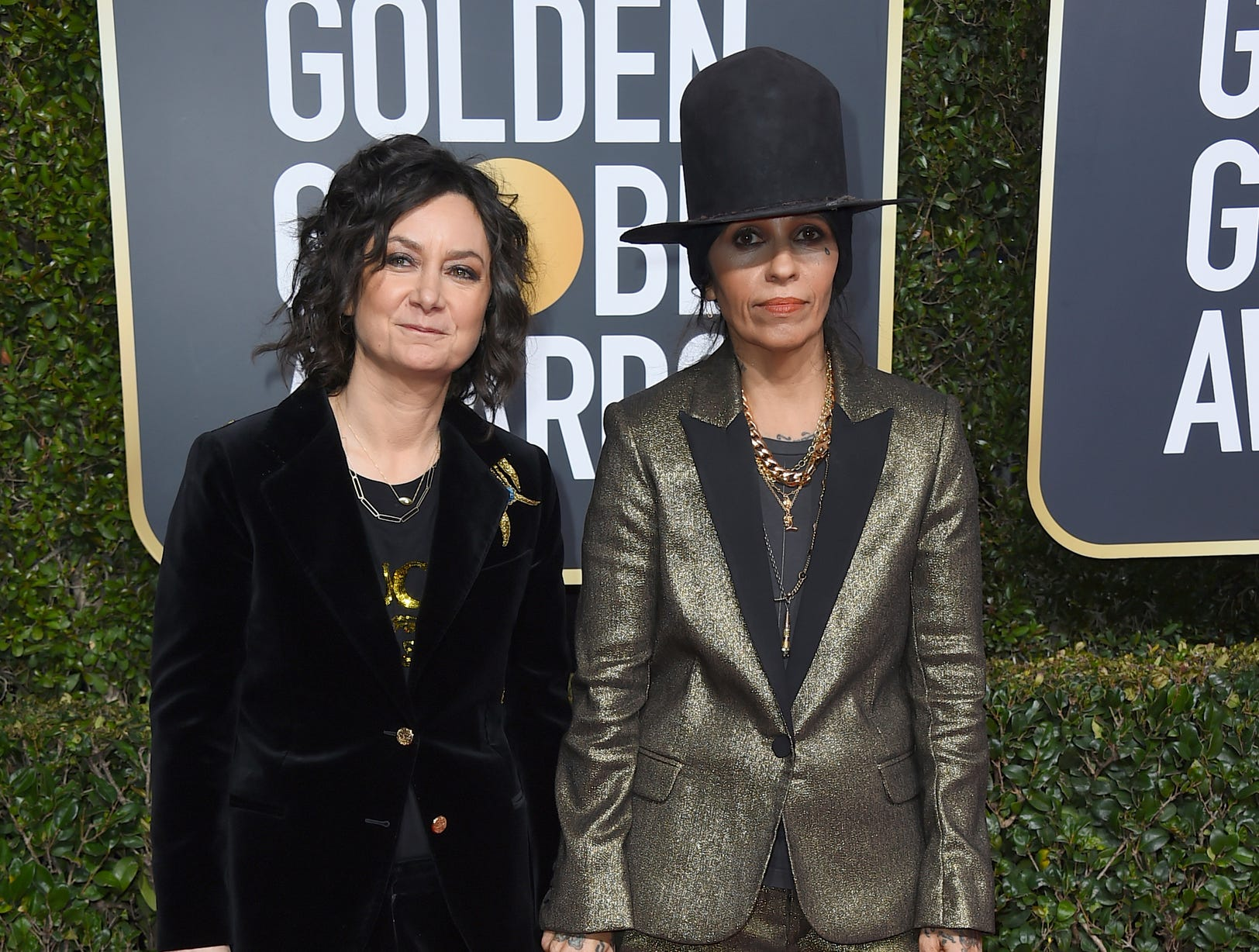 Sara Gilbert, left, and Linda Perry arrive at the 76th annual Golden Globe Awards at the Beverly Hilton Hotel.
