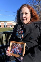 Kristy Loomis says she was abused as a child in Carson City by members of The Church at Carson City.  Loomis paused while working her job as a hospice nurse to visit with this photographer and show a picture of her and her mother and brothers shot in 1997 in Carson City.