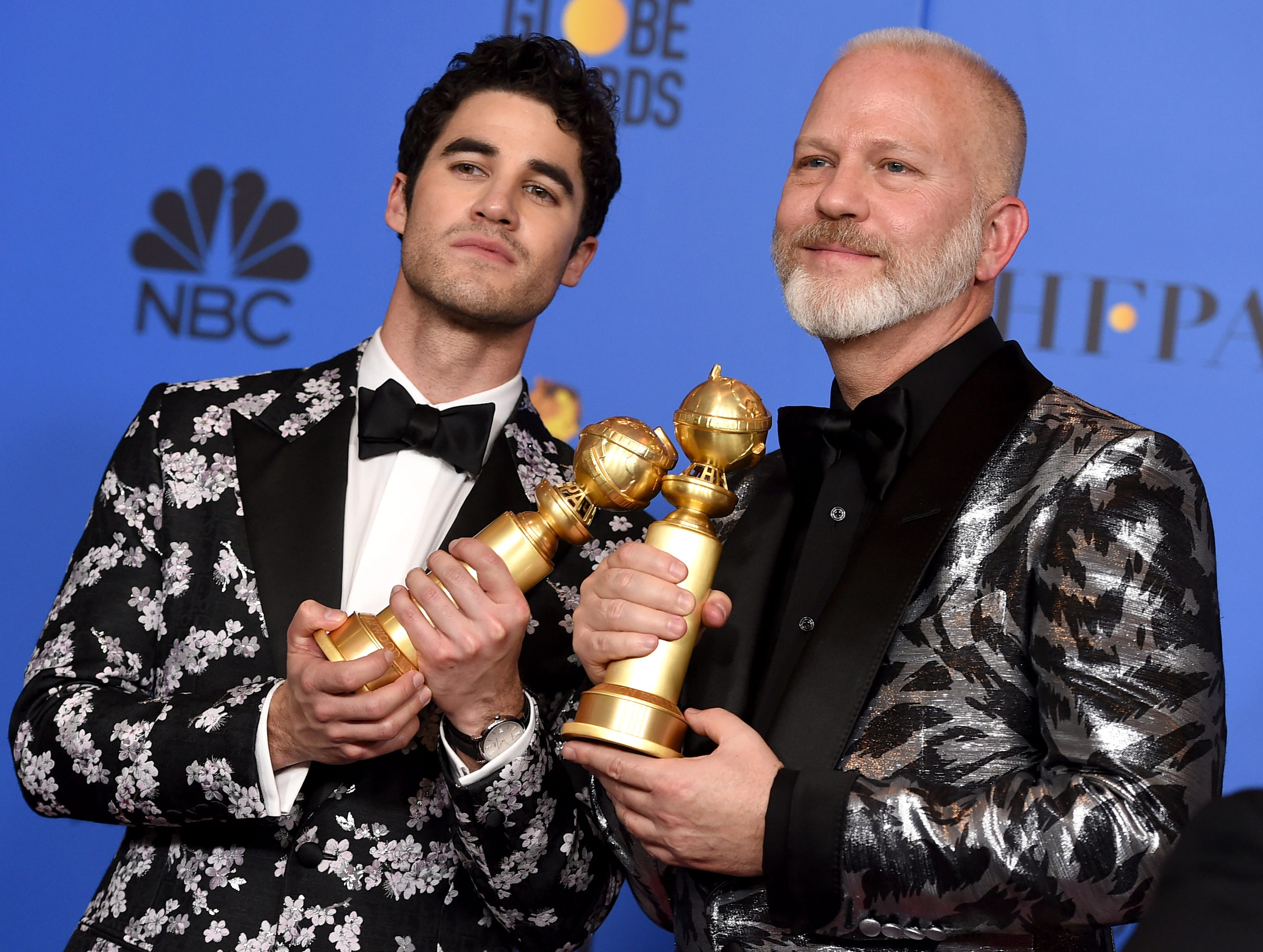 "Darren Criss, winner of the award for best performance by an actor in a limited series or a motion picture made for television, left, and Ryan Murphy, winner of the award for best television limited series or motion picture made for television, both for ""The Assassination of Gianni Versace: American Crime Story"" pose in the press room at the 76th annual Golden Globe Awards."