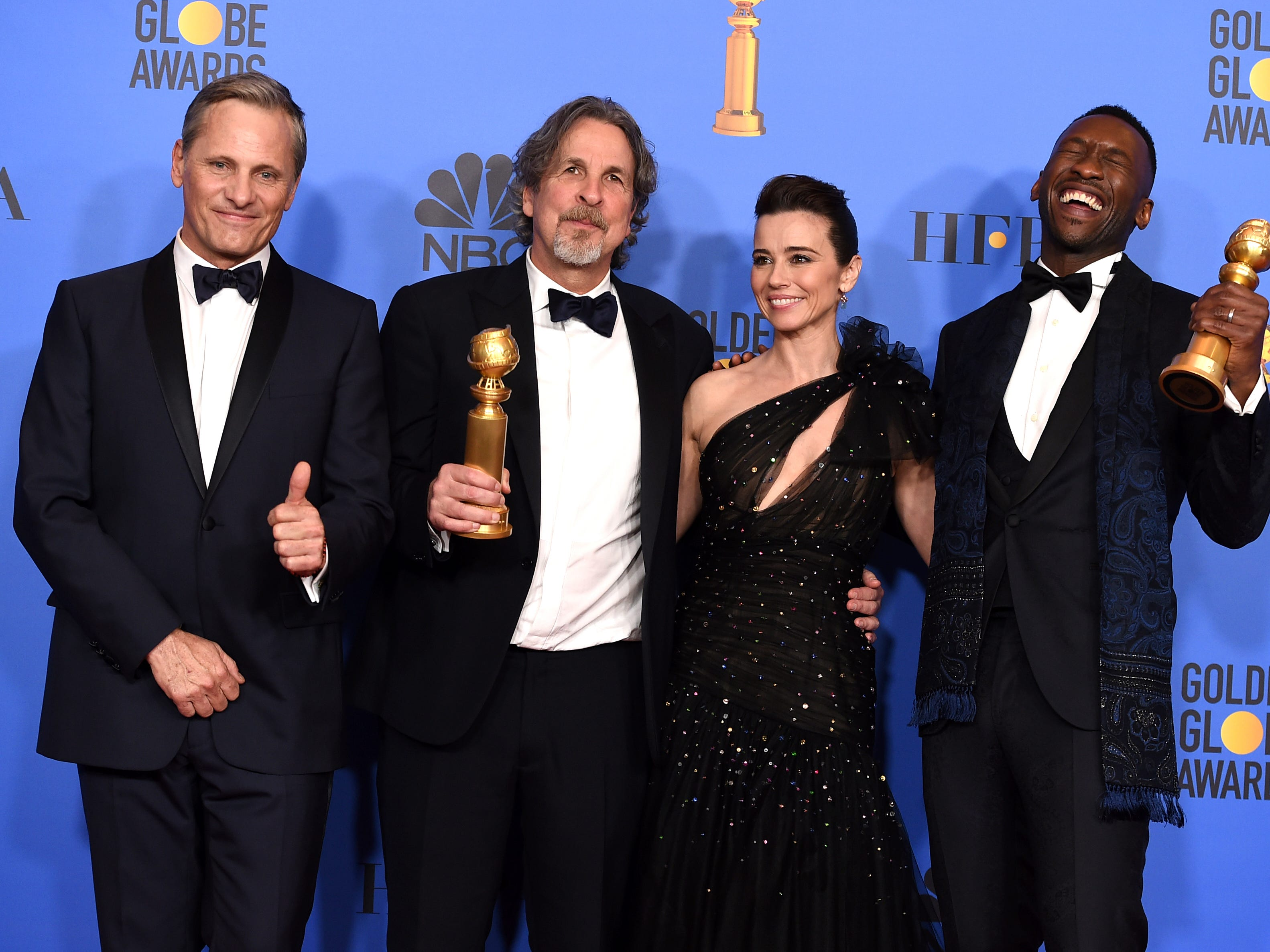 "Viggo Mortensen, from left, Peter Farrelly, Linda Cardellini and Mahershala Ali, winner of the award for best performance by an actor in a supporting role in any motion picture for ""Green Book"", pose in the press room with the award for best motion picture, musical or comedy for ""Green Book"" at the 76th annual Golden Globe Awards at the Beverly Hilton Hotel."