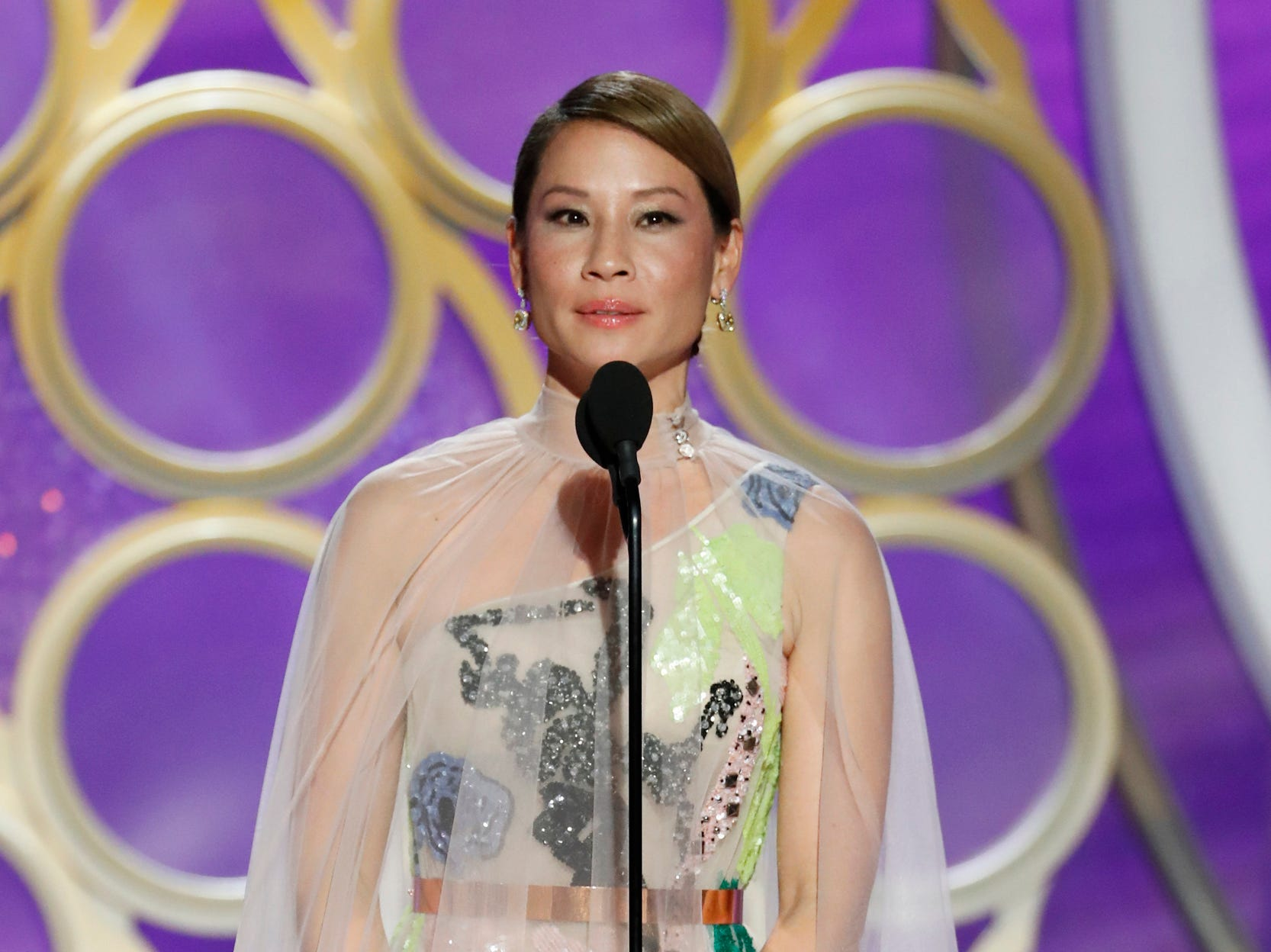 This image released by NBC shows presenter Lucy Liu during the 76th Annual Golden Globe Awards at the Beverly Hilton Hotel.