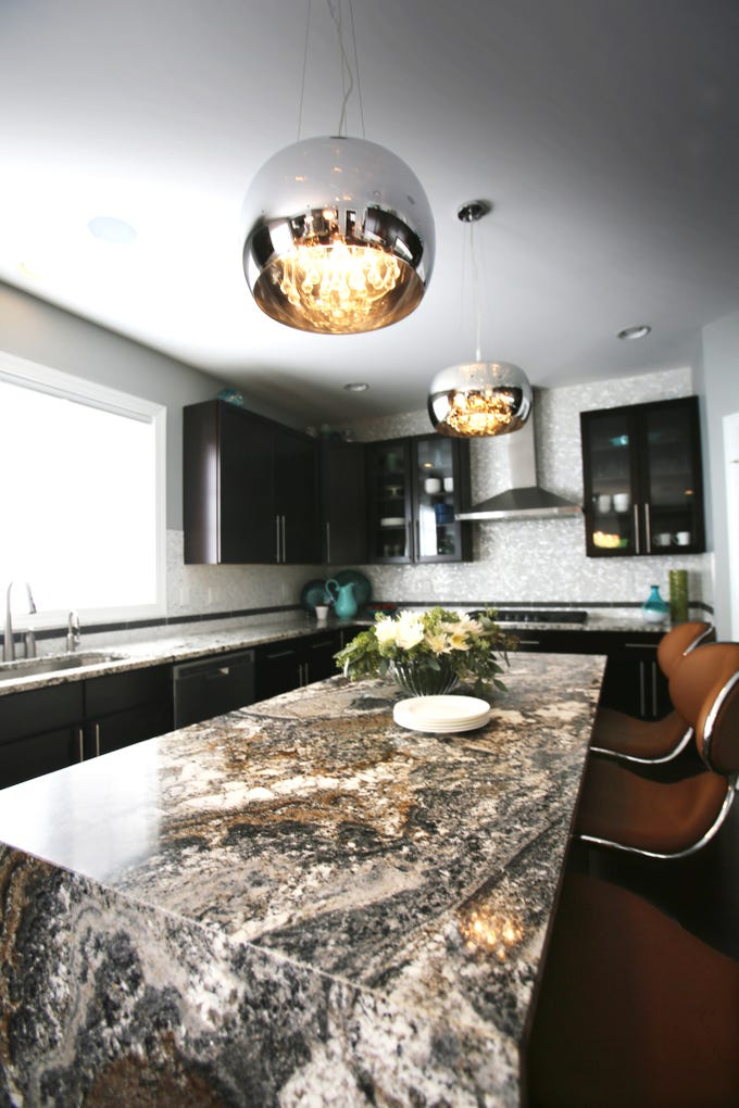 Killer light fixtures in a client's kitchen can be found in the $50 to $500 range, according to Dan Davis and Paul Johnson, co-owners of room2improve in Ferndale, a design consulting service.