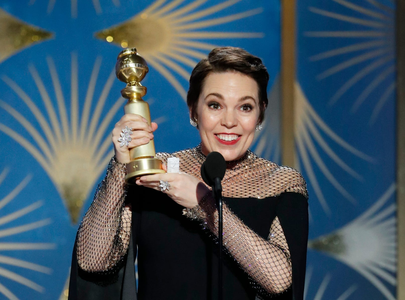 "This image released by NBC shows Olivia Colman accepting the award for best actress in a comedy film for her role in ""The Favourite"" during the 76th Annual Golden Globe Awards."
