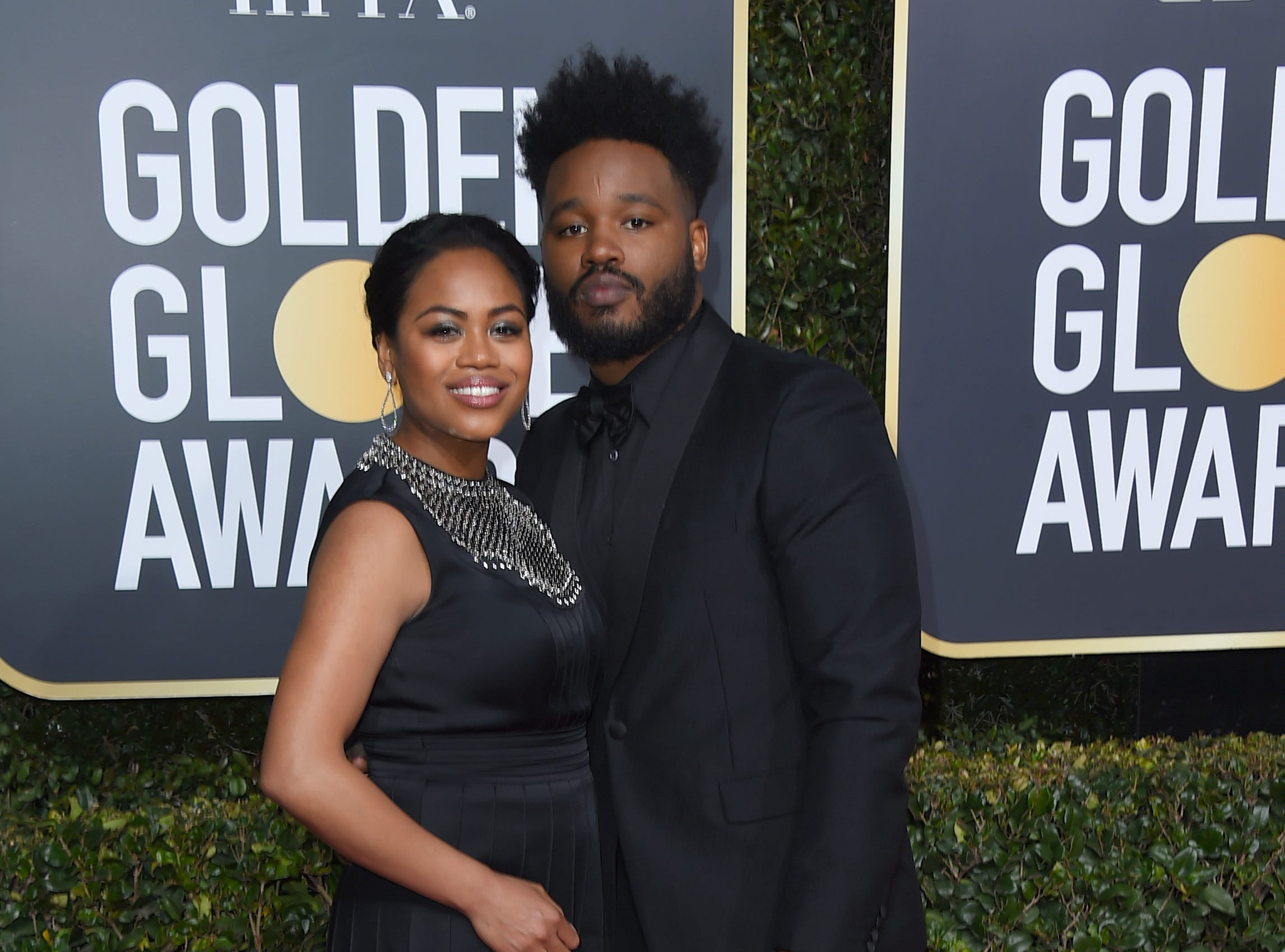 Ryan Coogler, right, and Zinzi Evans arrive at the 76th annual Golden Globe Awards at the Beverly Hilton Hotel.