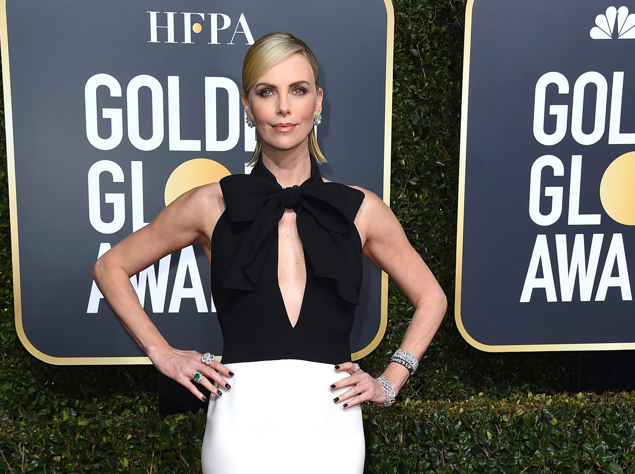 Charlize Theron arrives at the 76th annual Golden Globe Awards at the Beverly Hilton Hotel.