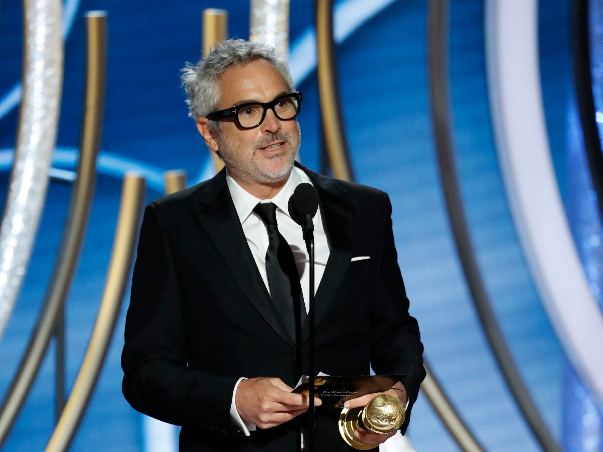 "This image released by NBC shows Alfonso Cuaron accepting the award for best foreign film for ""Roma"" during the 76th Annual Golden Globe Awards at the Beverly Hilton Hotel."