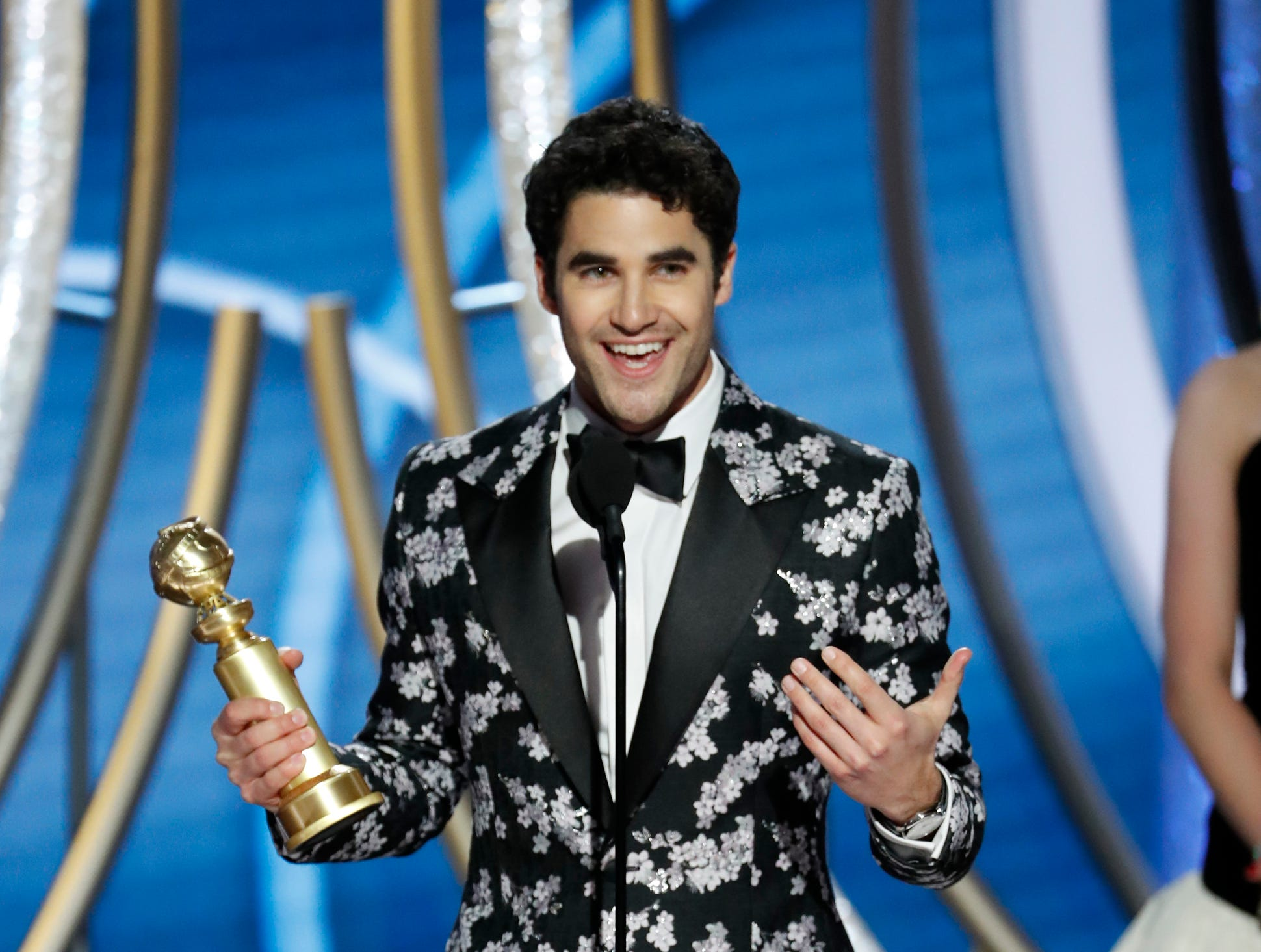 "This image released by NBC shows Darren Criss accepting the award for best actor in a limited series or picture made for TV for his role in ""The Assassination of Gianni Versace: American Crime Story"" during the 76th Annual Golden Globe Awards at the Beverly Hilton Hotel."