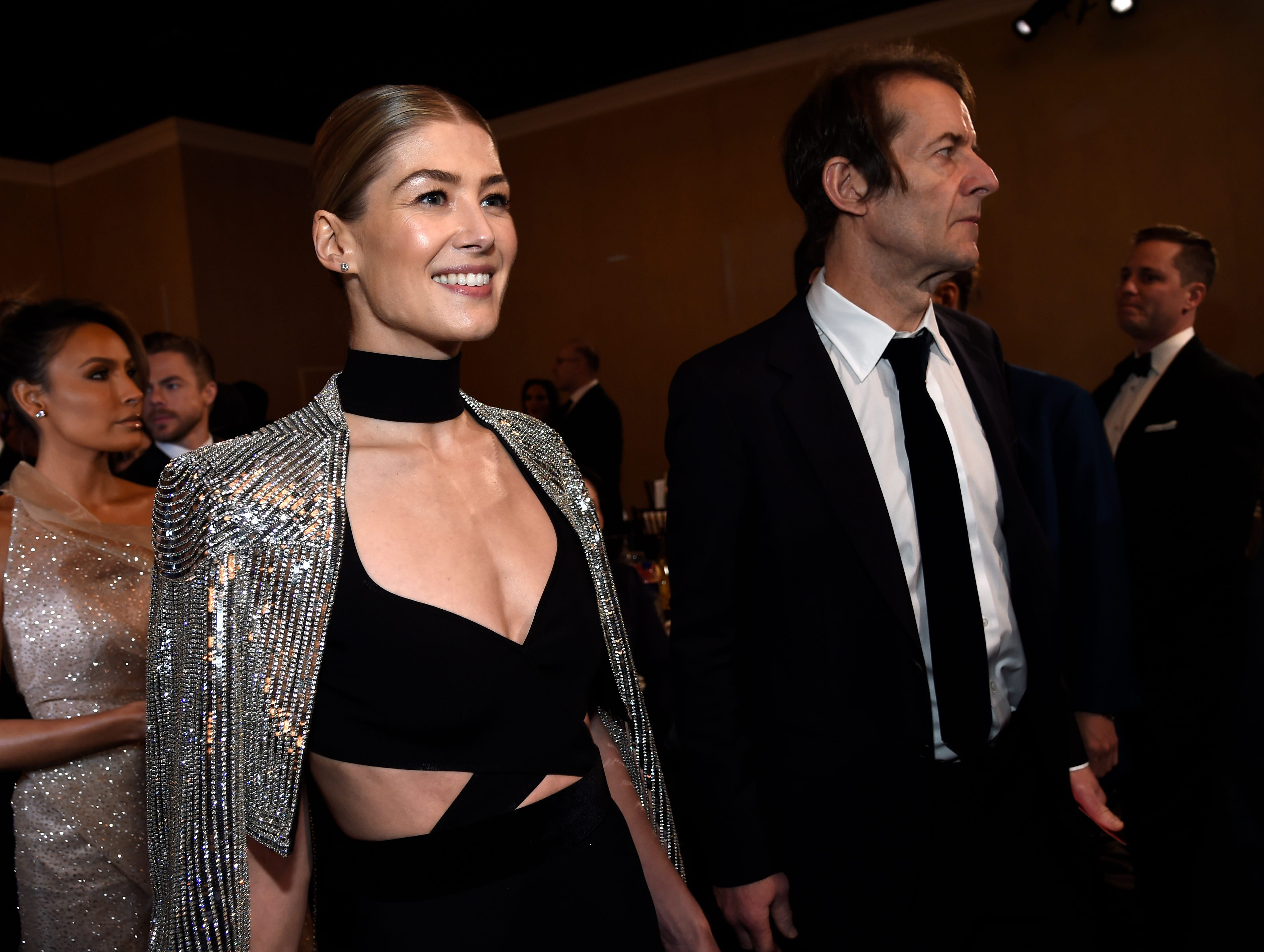 Rosamund Pike, left, and Robie Uniacke attend the 76th annual Golden Globe Awards at the Beverly Hilton Hotel.