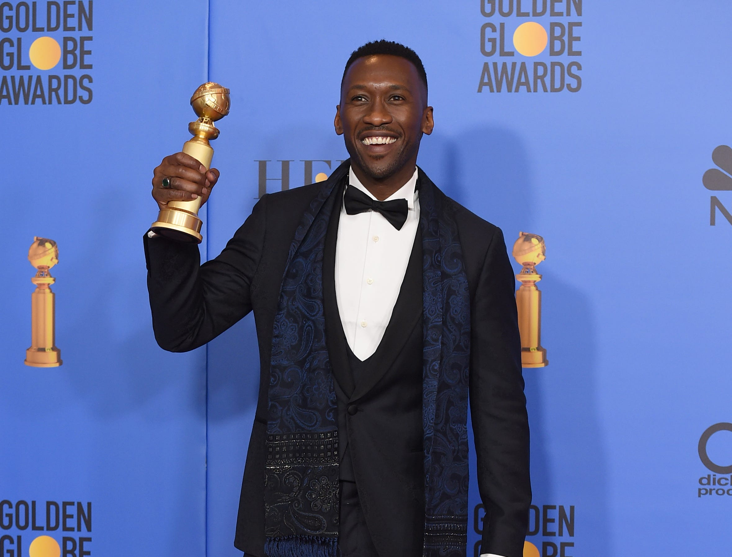 "Mahershala Ali poses in the press room with the award for best performance by an actor in a supporting role in any motion picture for ""Green Book"" at the 76th annual Golden Globe Awards at the Beverly Hilton Hotel."