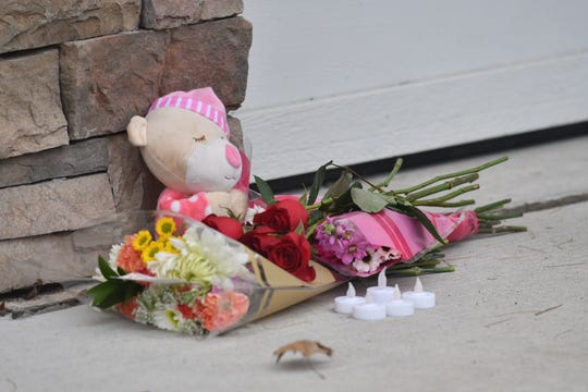 Flowers, candles and a stuffed animal memorialize the tragic deaths of all five members of the Abbas family outside their home in Northville, Michigan on January 7 2019.