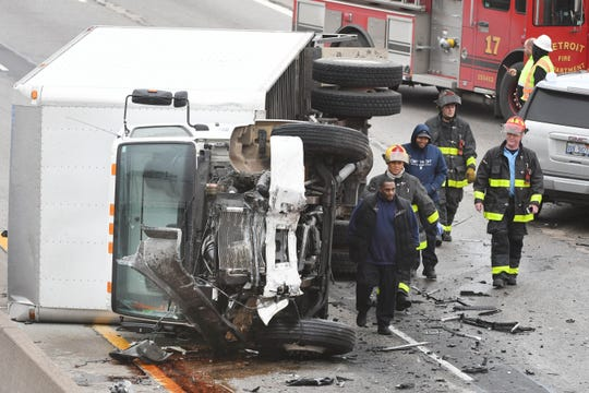 Police and firefighters work at the scene of a multi-vehicle accident on I-94 near Brush in Detroit, Monday afternoon.