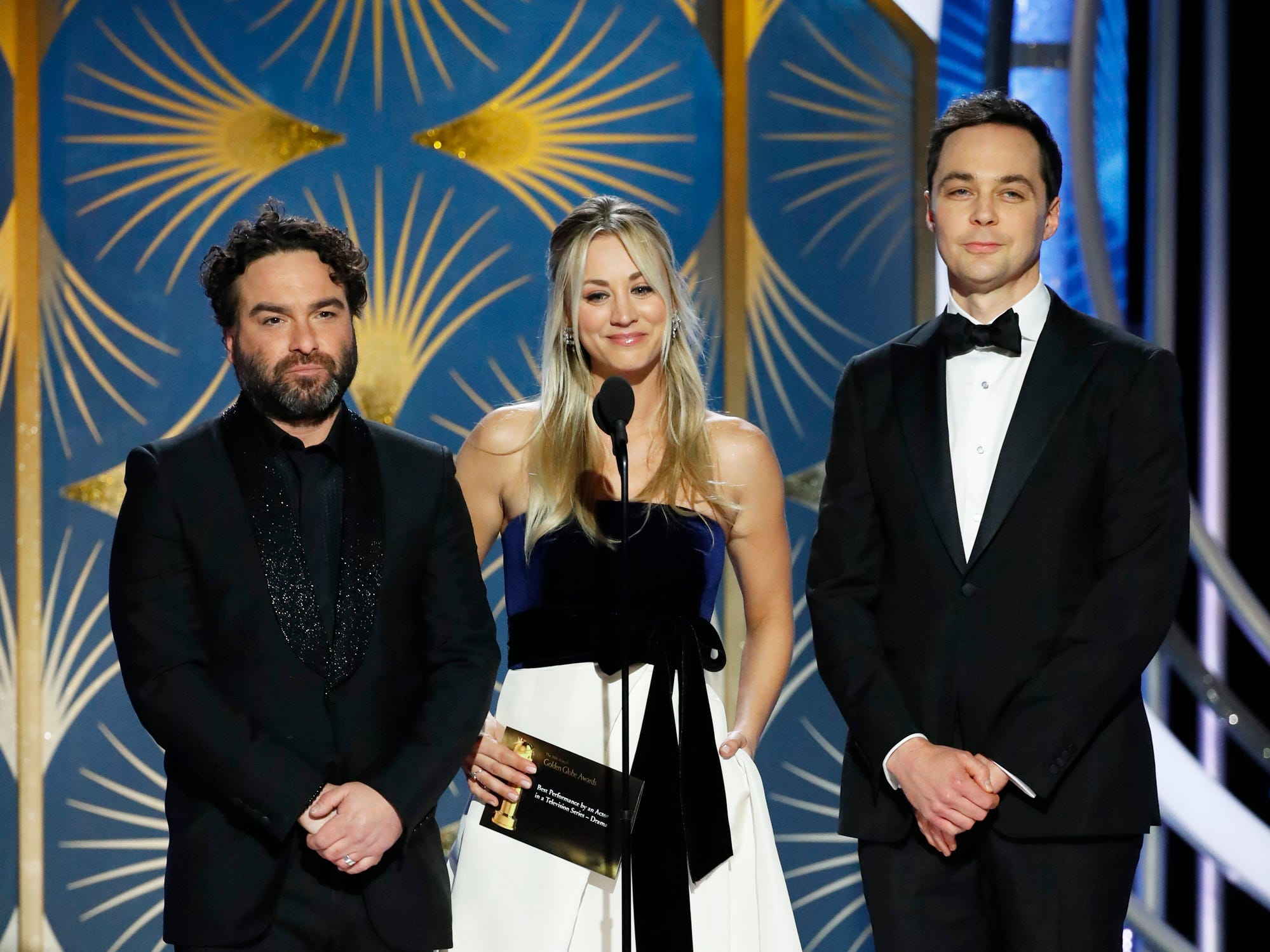 This image released by NBC shows presenters Johnny Galecki, from left, Kelly Cuoco, Jim Parsons during the 76th Annual Golden Globe Awards at the Beverly Hilton Hotel.