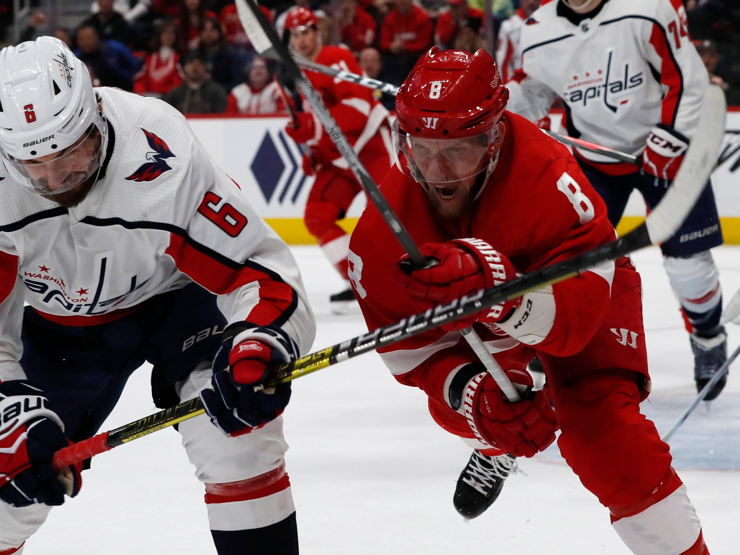 Washington Capitals defenseman Michal Kempny (6) holds back Detroit Red Wings left wing Justin Abdelkader (8) during the third period.