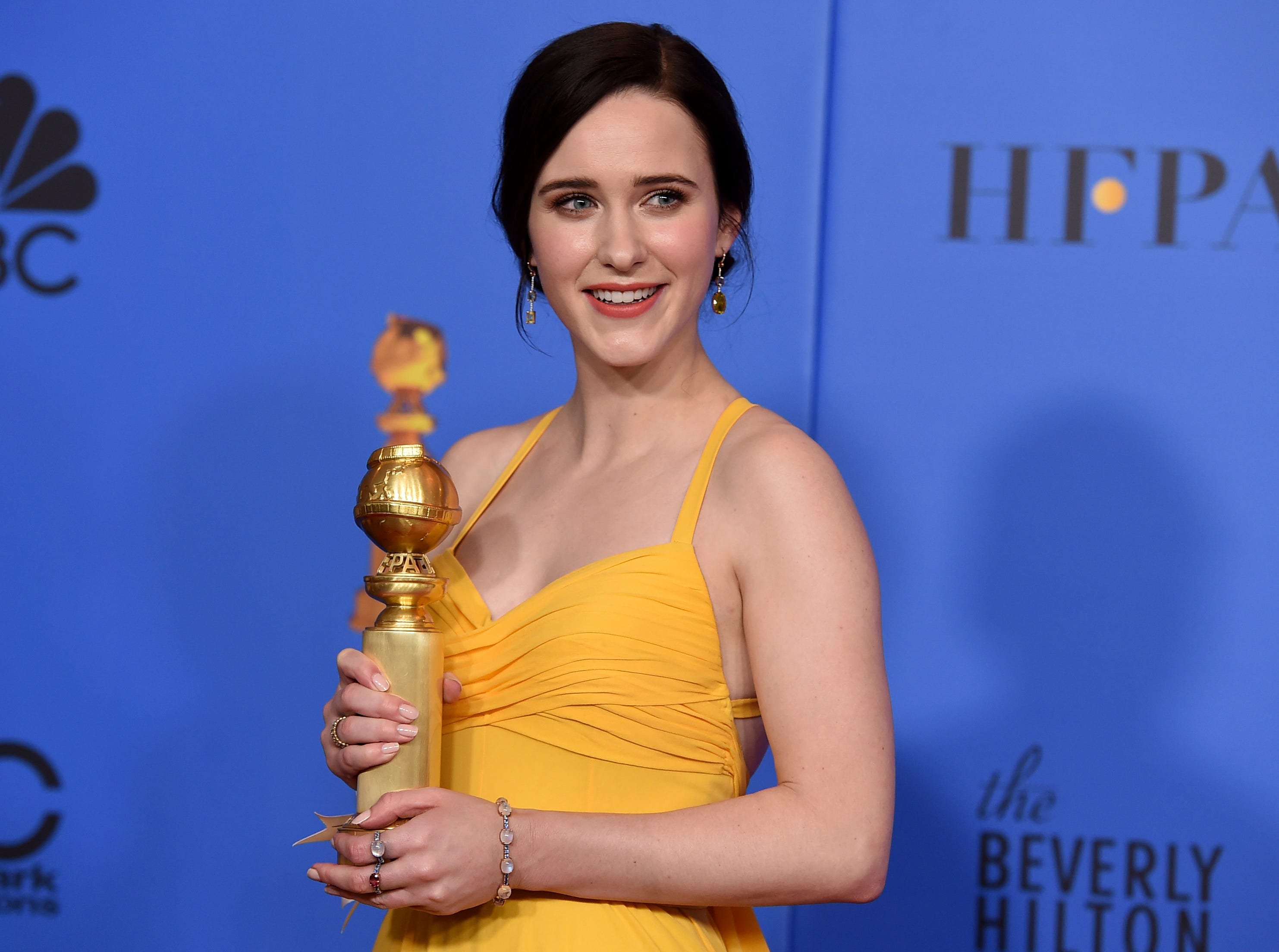 "Rachel Brosnahan poses in the press room with the award for best performance by an actress in a television series, musical or comedy for ""The Marvelous Mrs. Maisel"" at the 76th annual Golden Globe Awards at the Beverly Hilton Hotel."