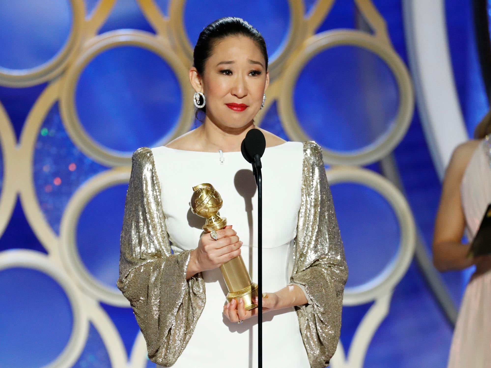 "This image released by NBC shows Sandra Oh accepting the award for best actress in a drama series for her role in ""Killing Eve"" during the 76th Annual Golden Globe Awards at the Beverly Hilton Hotel."