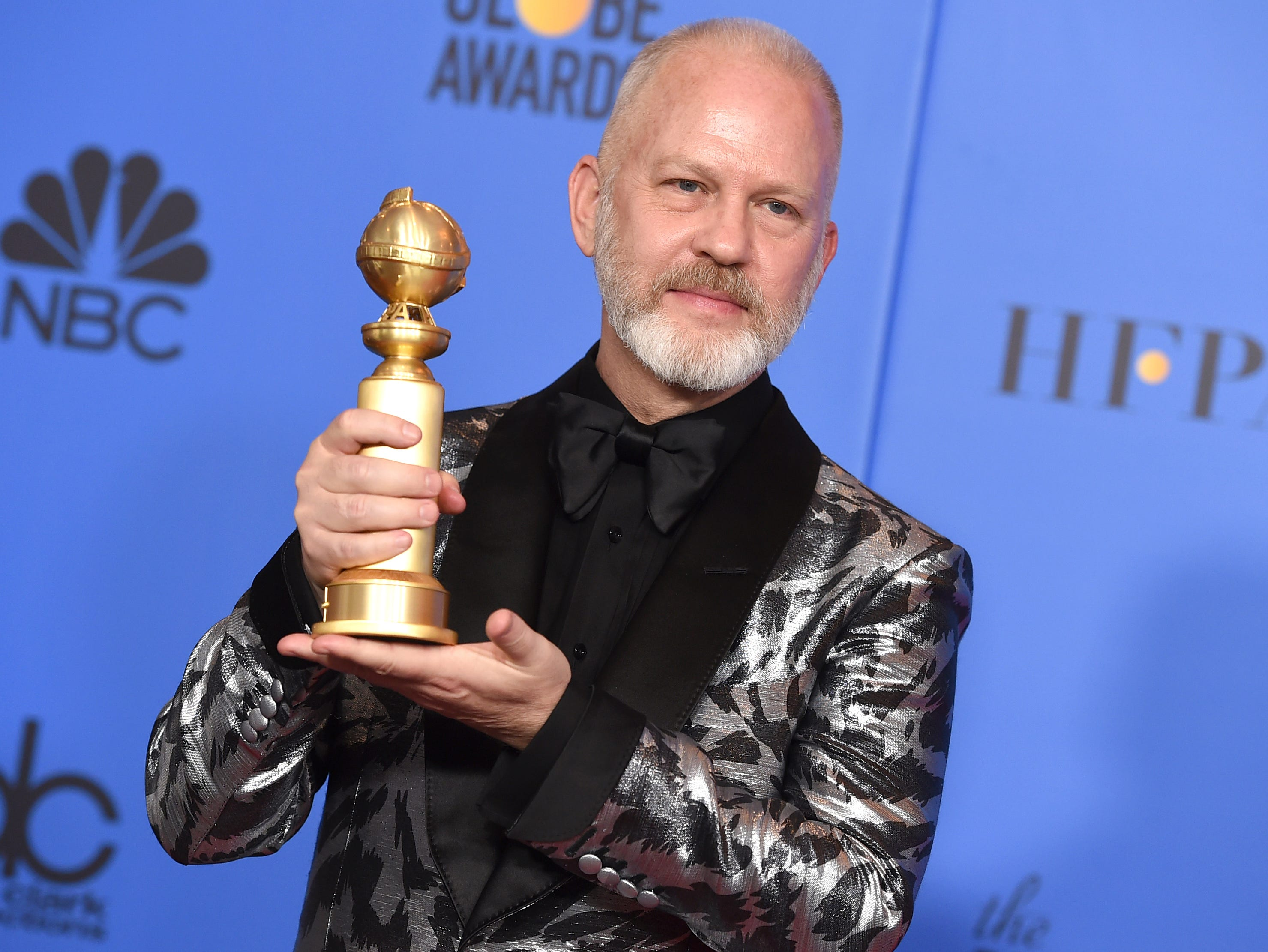 "Ryan Murphy poses in the press room with the award for best television limited series or motion picture made for television for ""The Assassination of Gianni Versace: American Crime Story"" at the 76th annual Golden Globe Awards at the Beverly Hilton Hotel."