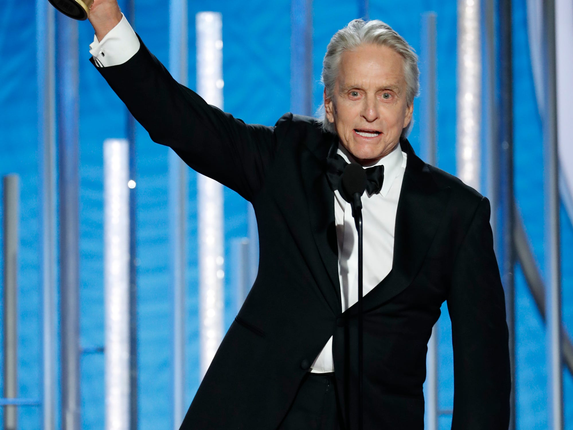 "This image released by NBC shows Michael Douglas, winner of best actor in a TV series, musical or comedy for his role in ""The Kominsky Method"" at the 76th Annual Golden Globe Awards at the Beverly Hilton Hotel."