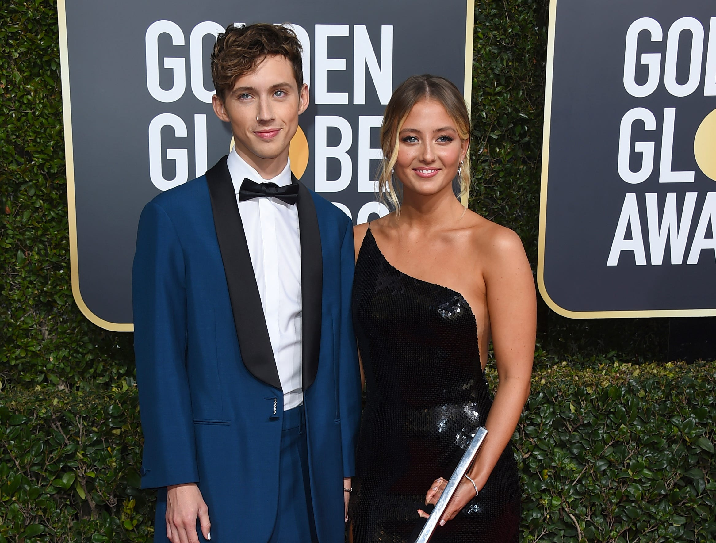 Troye Sivan, left, and Sage Sivan arrive at the 76th annual Golden Globe Awards at the Beverly Hilton Hotel.