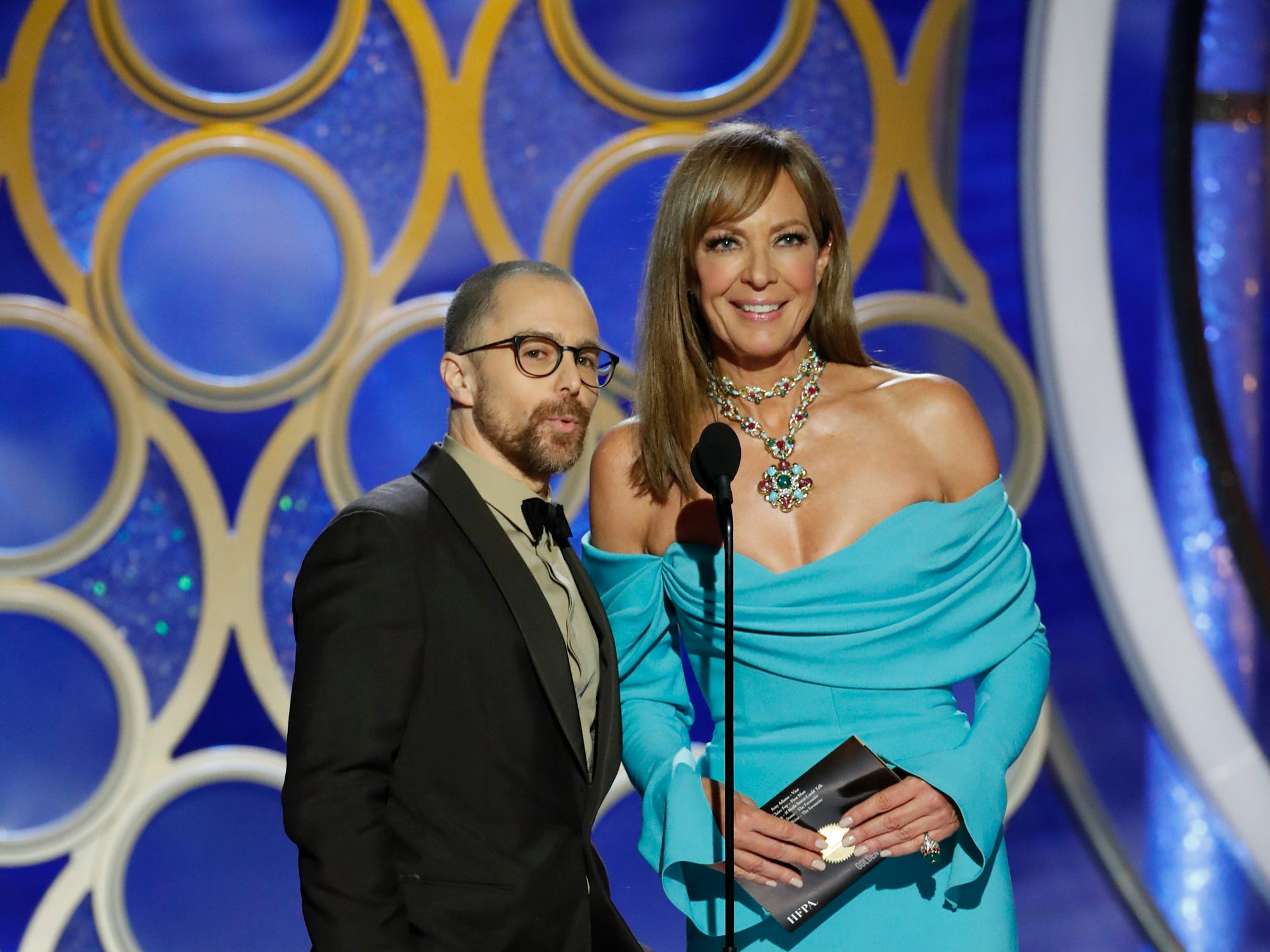 This image released by NBC shows presenters Sam Rockwell, left, and Allison Janney during the 76th Annual Golden Globe Awards at the Beverly Hilton Hotel.