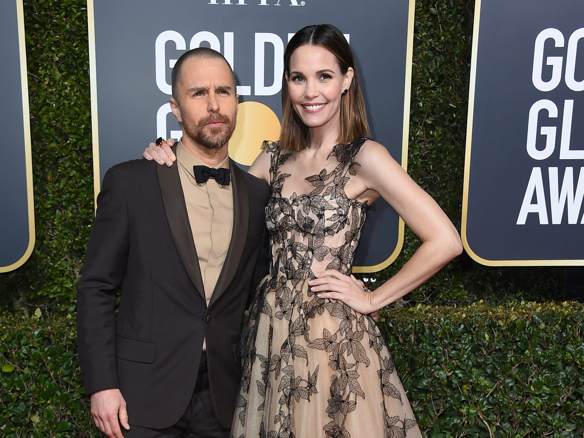 Sam Rockwell, left, and Leslie Bibb arrive at the 76th annual Golden Globe Awards at the Beverly Hilton Hotel.