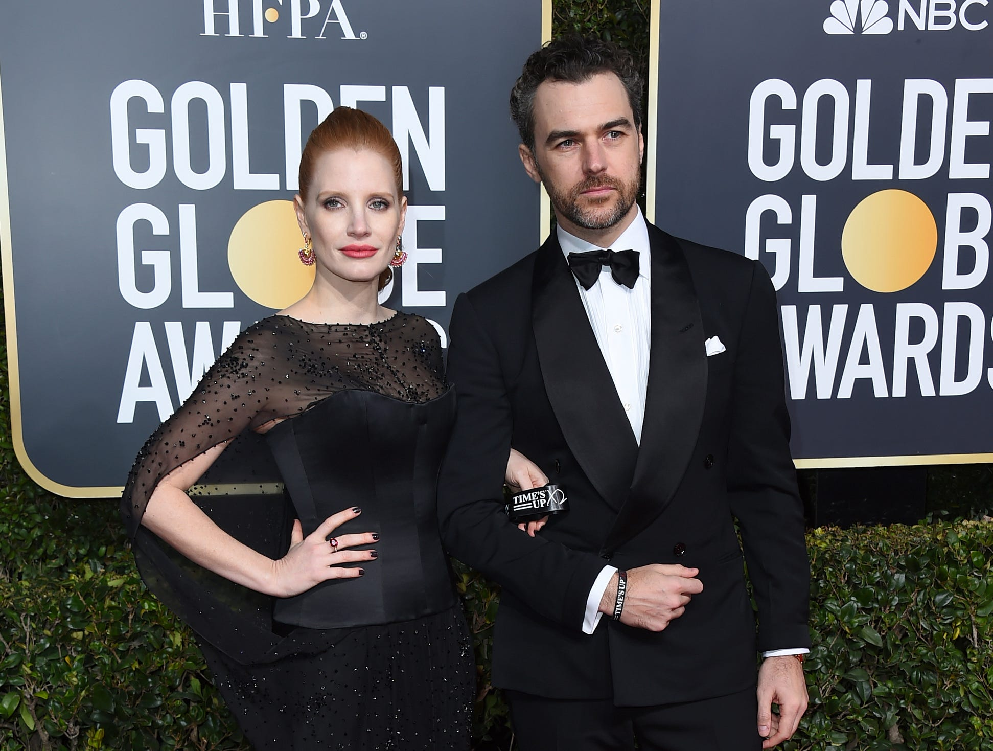 Jessica Chastain, left, and Gian Luca Passi de Preposulo arrive at the 76th annual Golden Globe Awards at the Beverly Hilton Hotel.