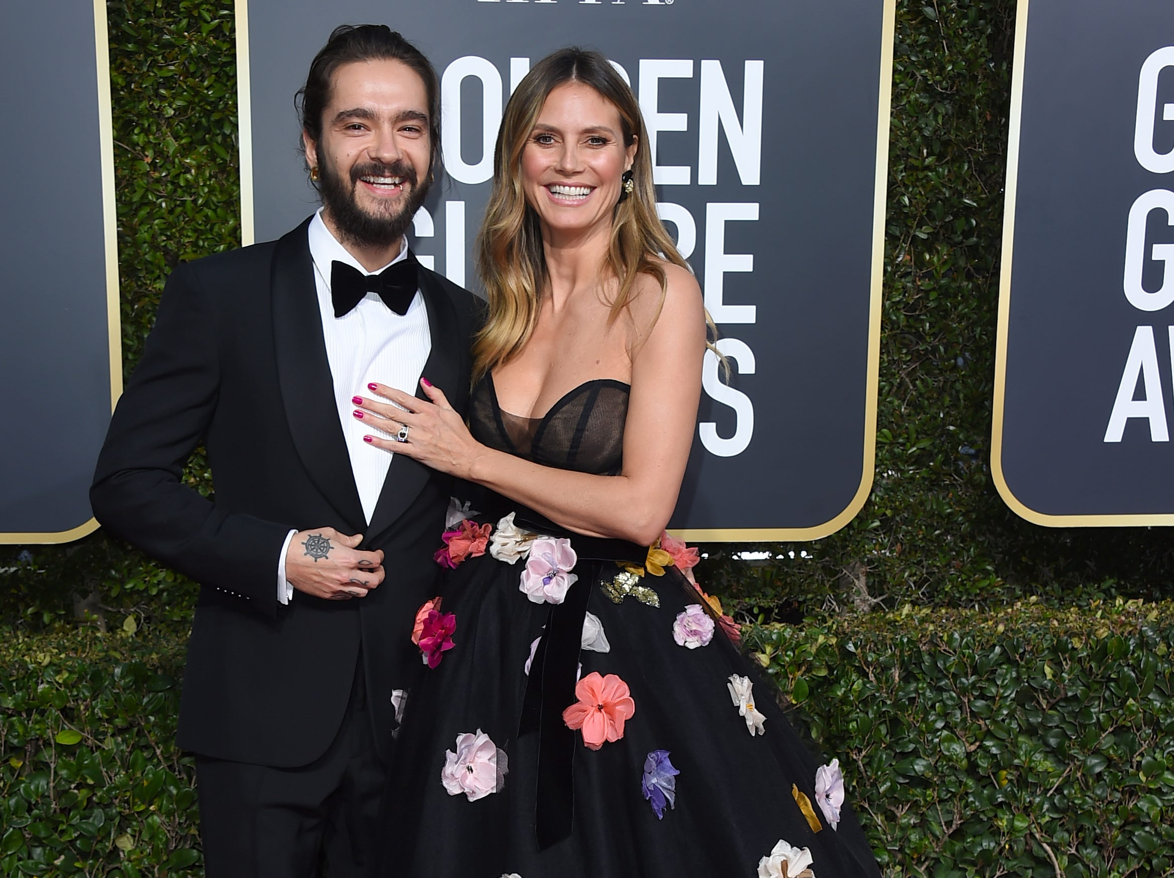 Tom Kaulitz, left, and Heidi Klum arrive at the 76th annual Golden Globe Awards at the Beverly Hilton Hotel.