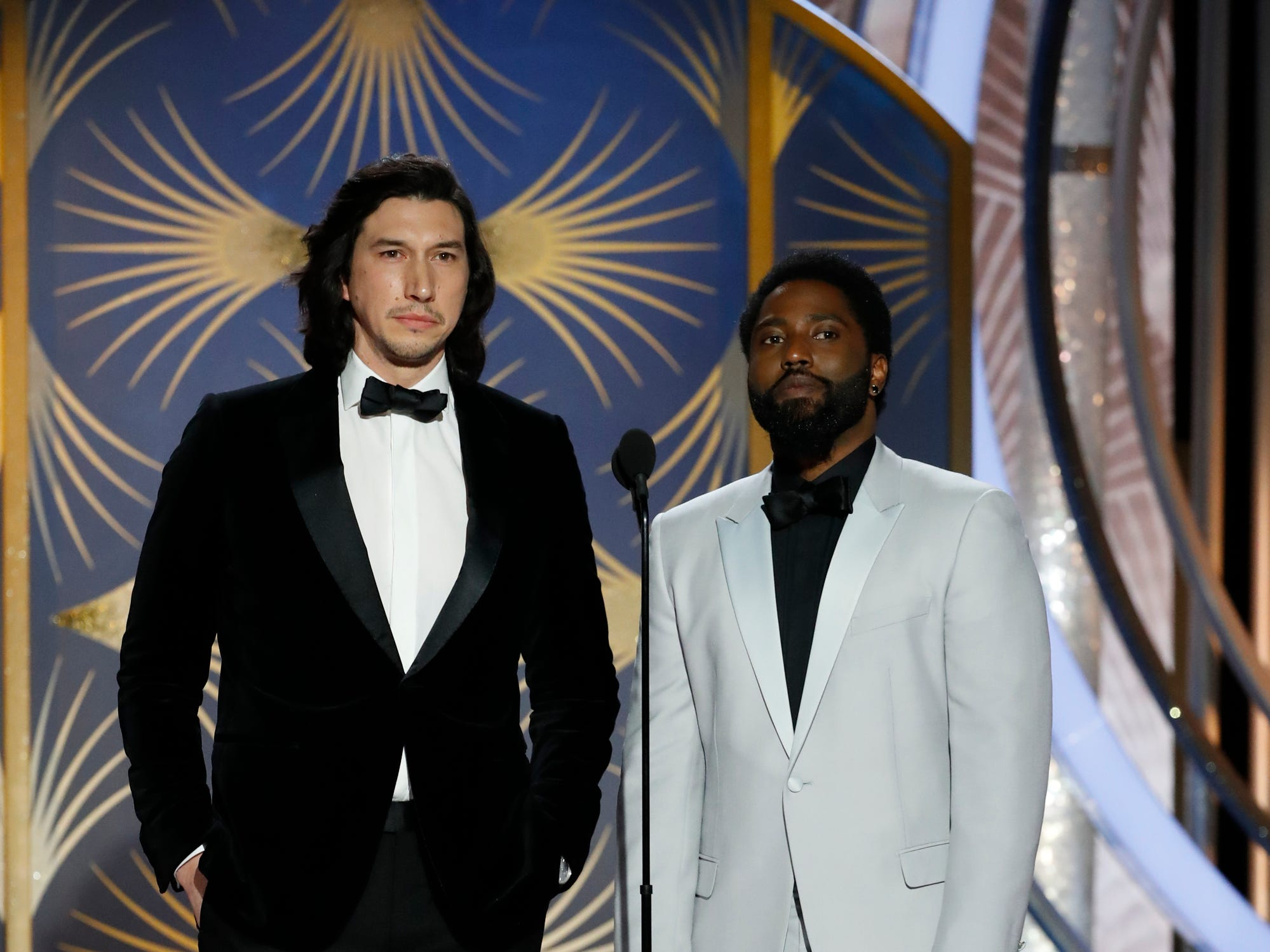 This image released by NBC shows presenters Adam Driver, left, and John David Washington during the 76th Annual Golden Globe Awards at the Beverly Hilton Hotel.