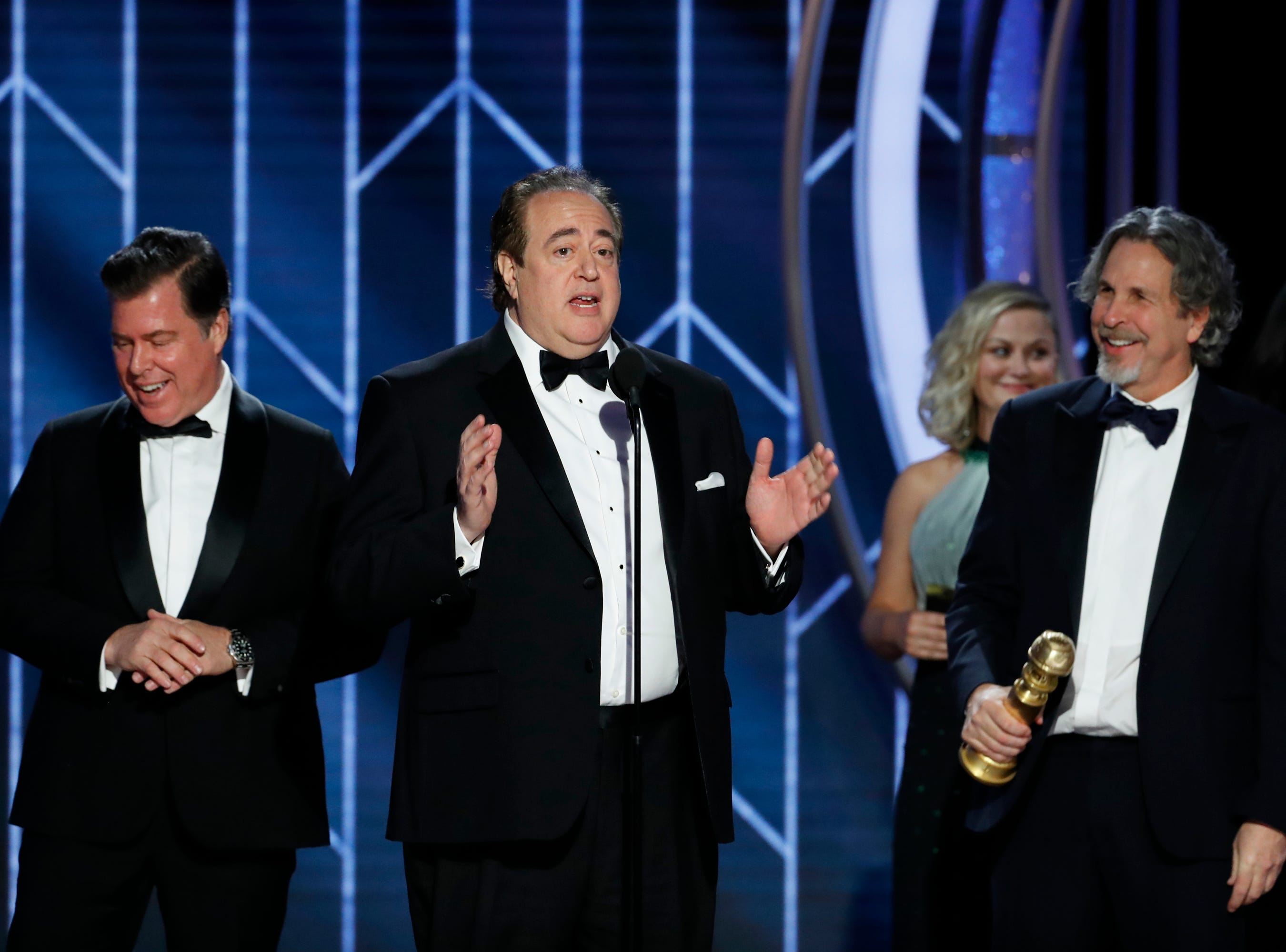 "This image released by NBC shows Nick Vallelonga accepting the award for best screenplay for ""Green Book"" during the 76th Annual Golden Globe Awards at the Beverly Hilton Hotel."