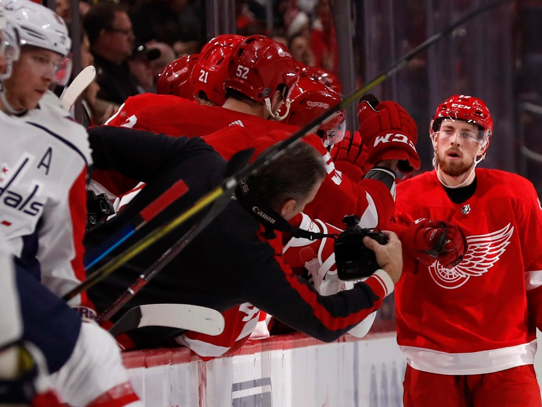 Detroit Red Wings defenseman Filip Hronek is congratulated by teammates after scoring during the second period.