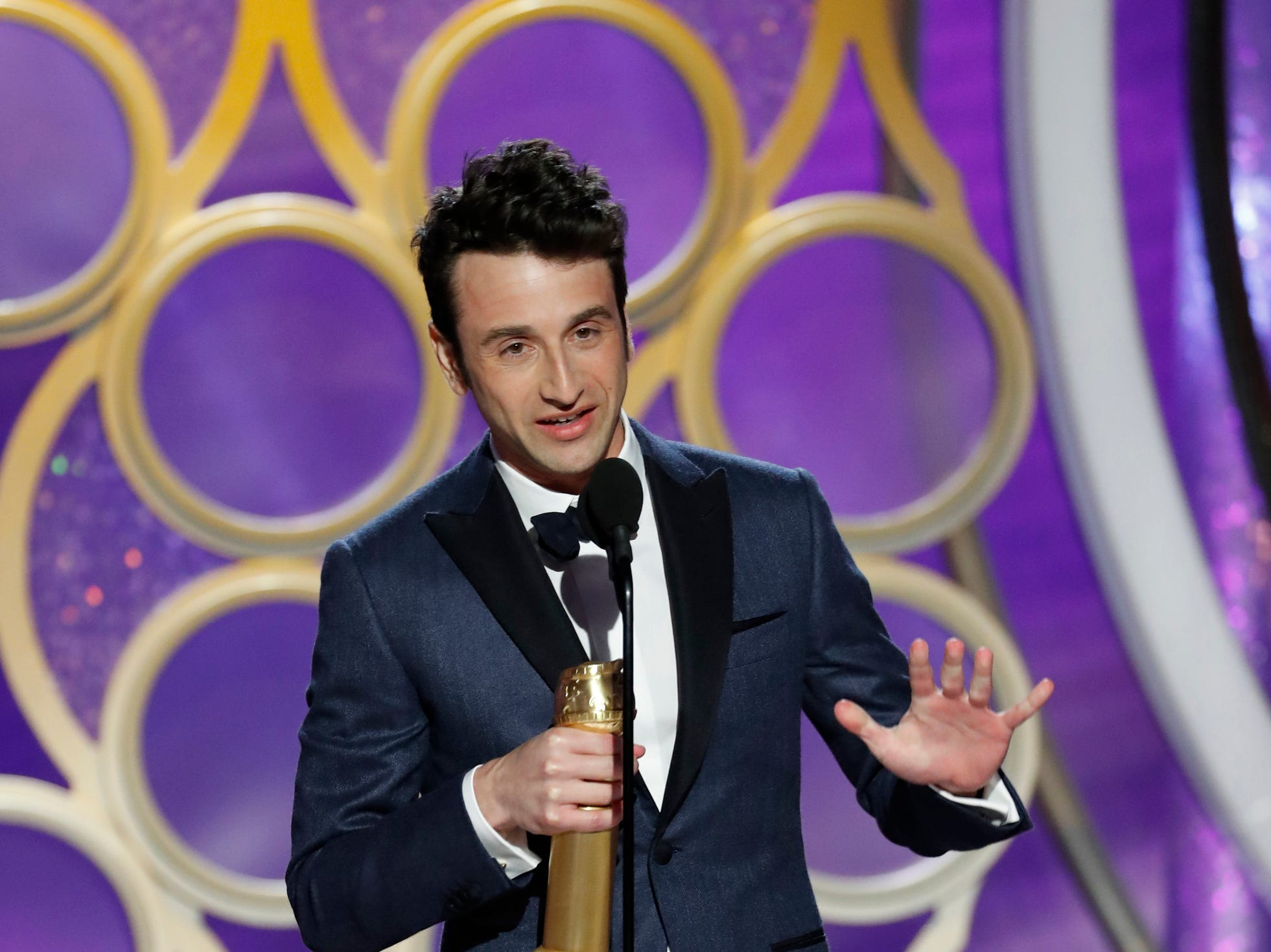 "This image released by NBC shows Justin Hurwitz accepting the award for best original score for ""First Man"" during the 76th Annual Golden Globe Awards at the Beverly Hilton Hotel."