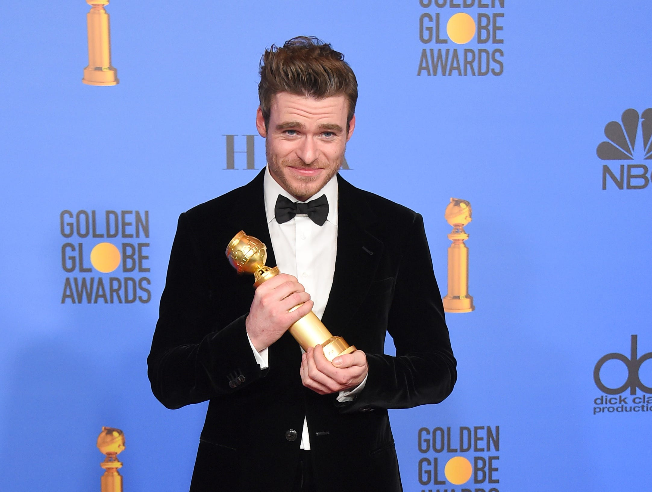 "Richard Madden poses in the press room with the award for best performance by an actor in a television series, drama for ""Bodyguard"" at the 76th annual Golden Globe Awards at the Beverly Hilton Hotel."