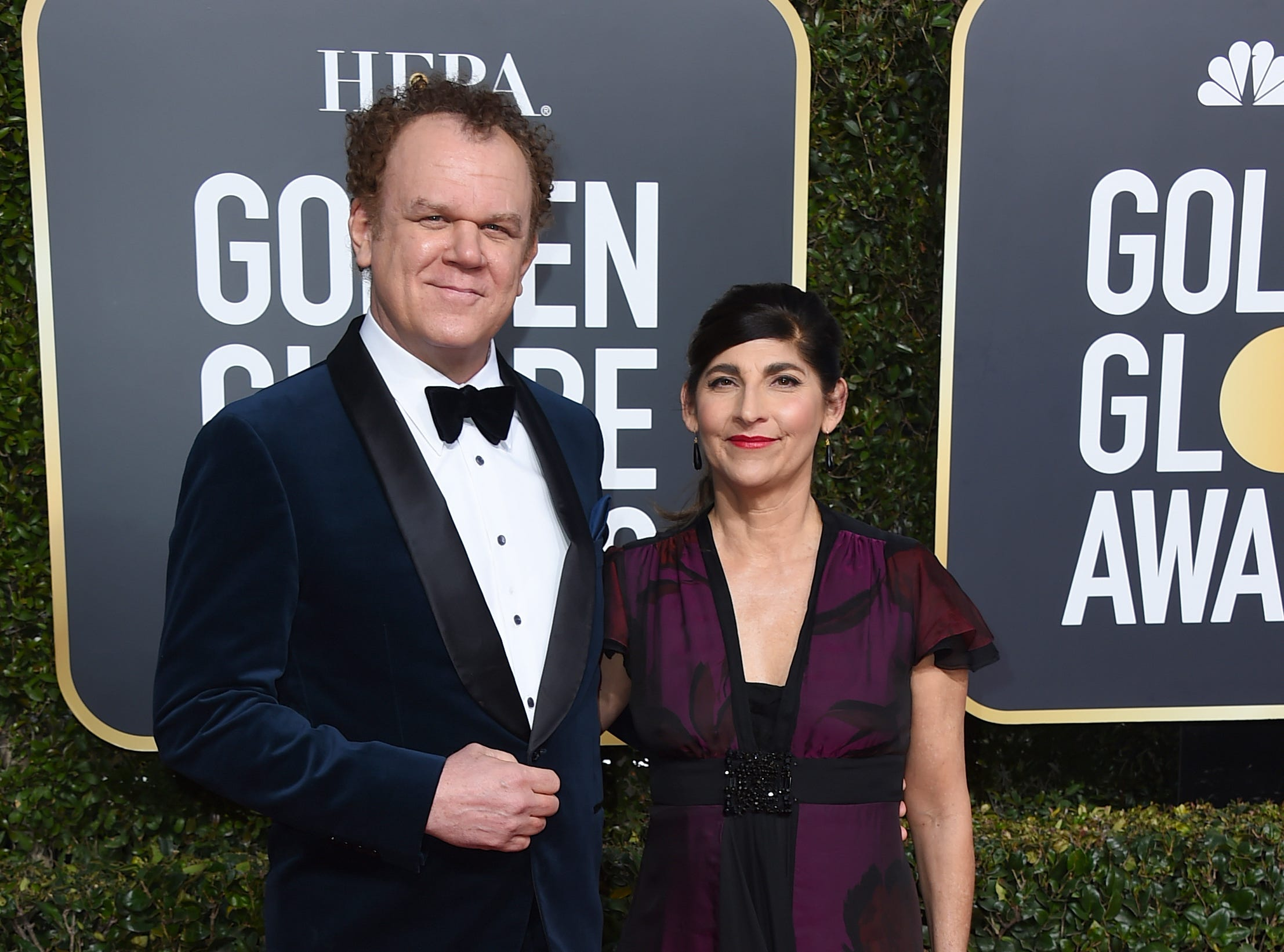 John C. Reilly, left, and Alison Dickey arrive at the 76th annual Golden Globe Awards at the Beverly Hilton Hotel.