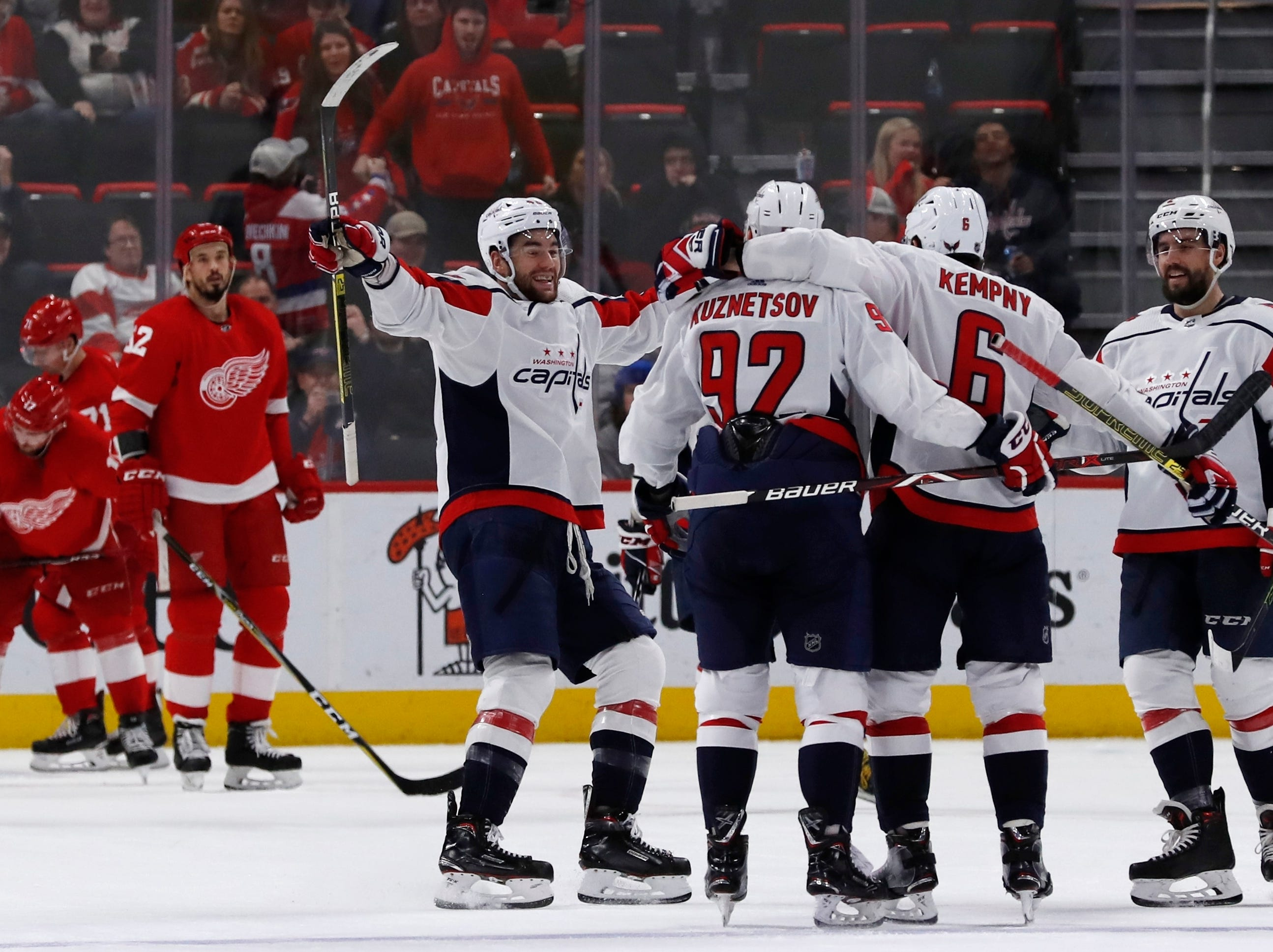The Washington Capitals celebrate their third goal during the third period of an NHL hockey game, Sunday, Jan. 6, 2019, in Detroit. Washington defeated Detroit 3-2.