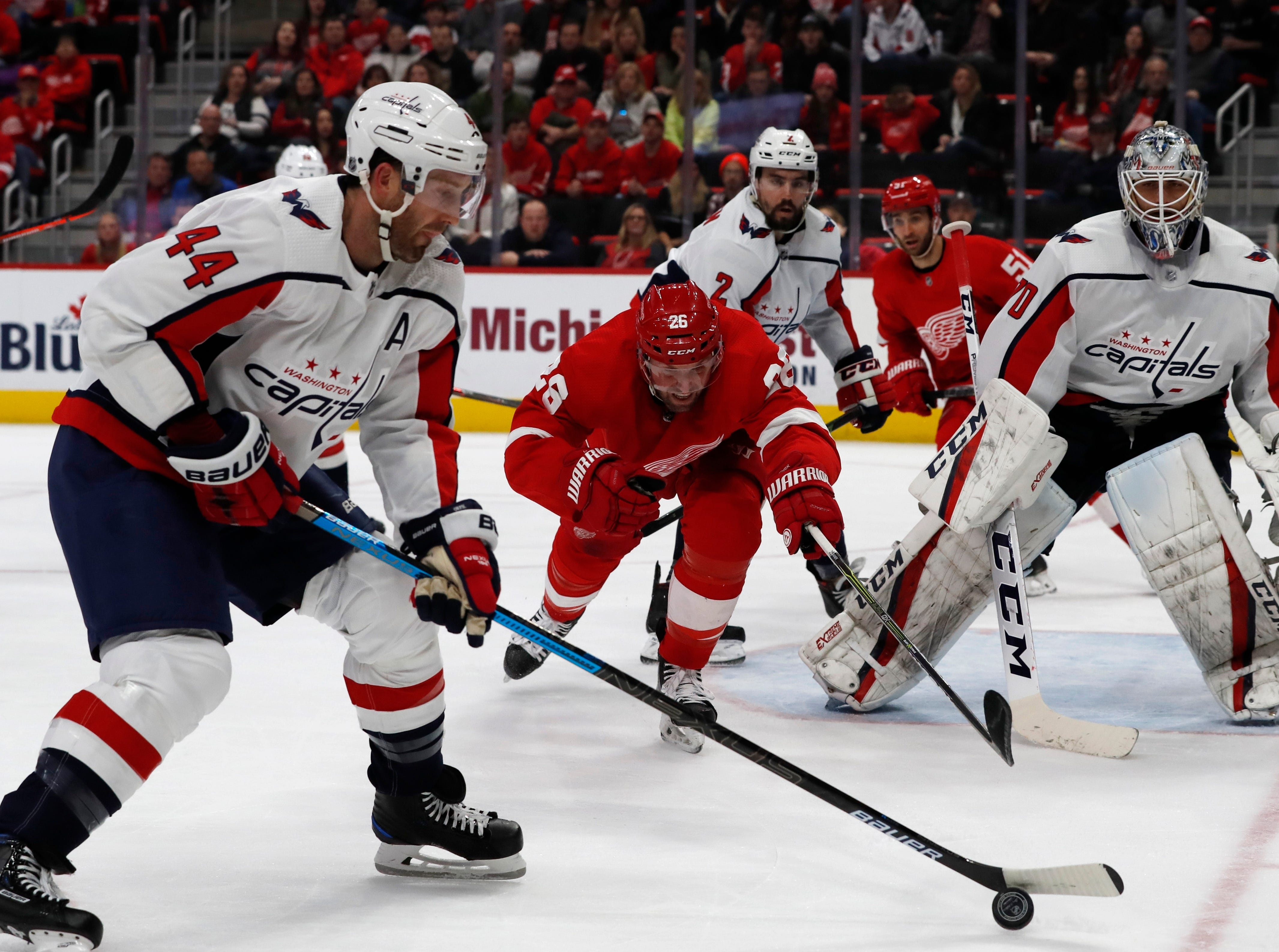 Washington Capitals defenseman Brooks Orpik (44) controls the puck as Detroit Red Wings left wing Thomas Vanek (26) reaches in during the third period.