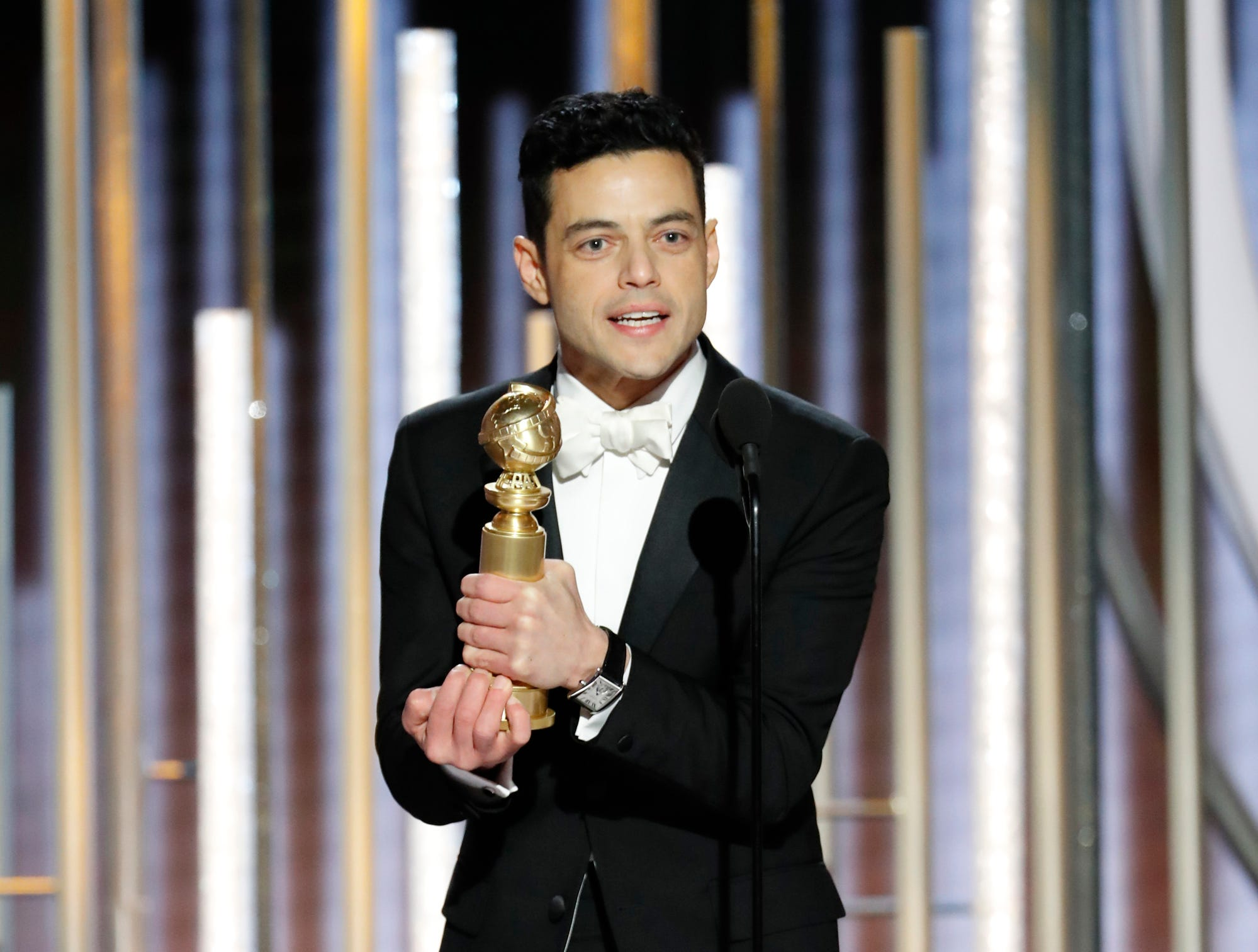 "This image released by NBC shows Rami Malek accepting the award for best actor in a motion picture drama for his role as Freddie Mercury in a scene from ""Bohemian Rhapsody"" during the 76th Annual Golden Globe Awards at the Beverly Hilton Hotel on Sunday, Jan. 6, 2019, in Beverly Hills, Calif."