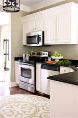 2595 With a budget of $5,000 and some online inspiration, a kitchen upgrade may be in the cards. One way to change the look is to add 2 by 4s and moldings to the cabinetry like Macklem did in her own home to emulate the high-end, tall uppers often found in custom kitchens. Her laminate countertops were replaced with granite and the cabinets were treated to a fresh coat of paint.