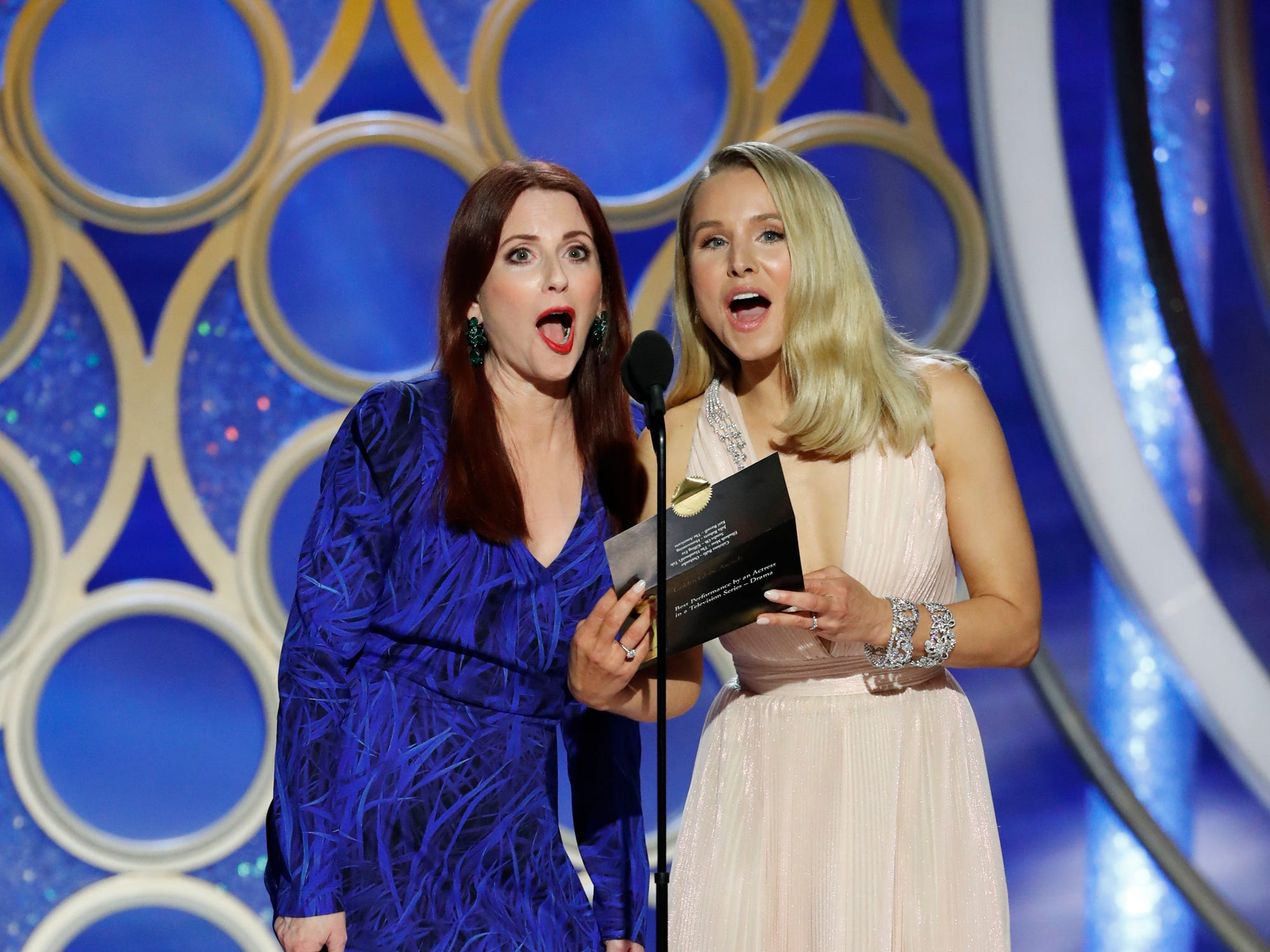 This image released by NBC shows presenters Megan Mullally, left, and Kristin Bell during the 76th Annual Golden Globe Awards at the Beverly Hilton Hotel.