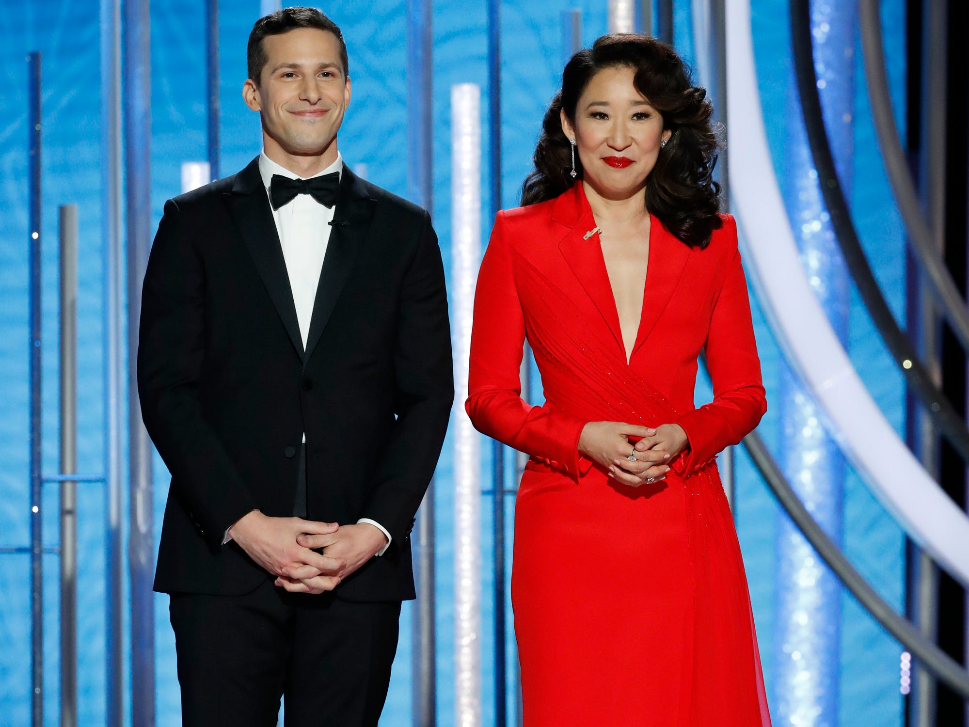 This image released by NBC shows hosts Andy Samberg, left, and Sandra Oh at the 76th Annual Golden Globe Awards.