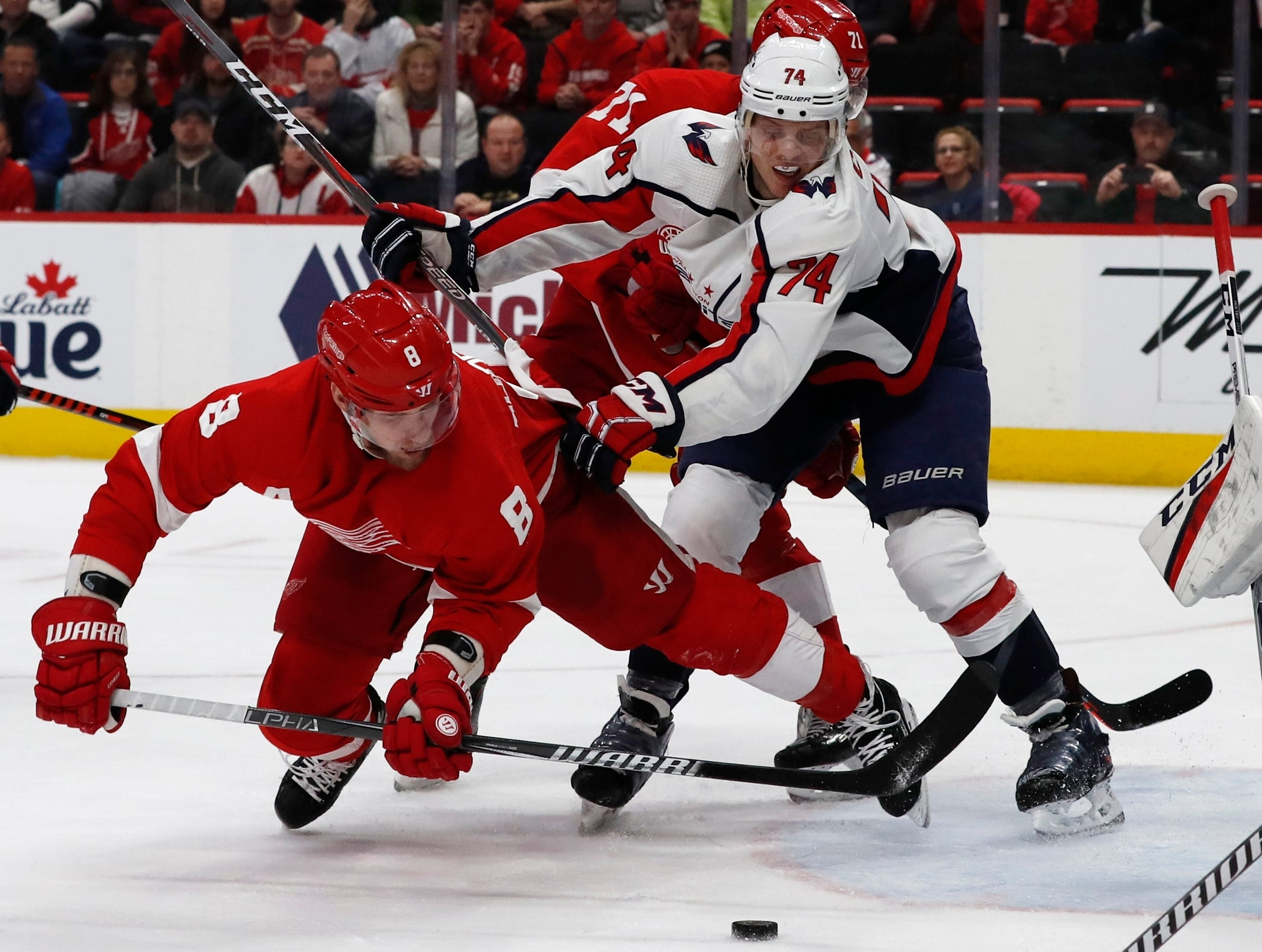 Detroit Red Wings left wing Justin Abdelkader (8) shoots toward the net as Washington Capitals defenseman John Carlson (74) defends during the third period.