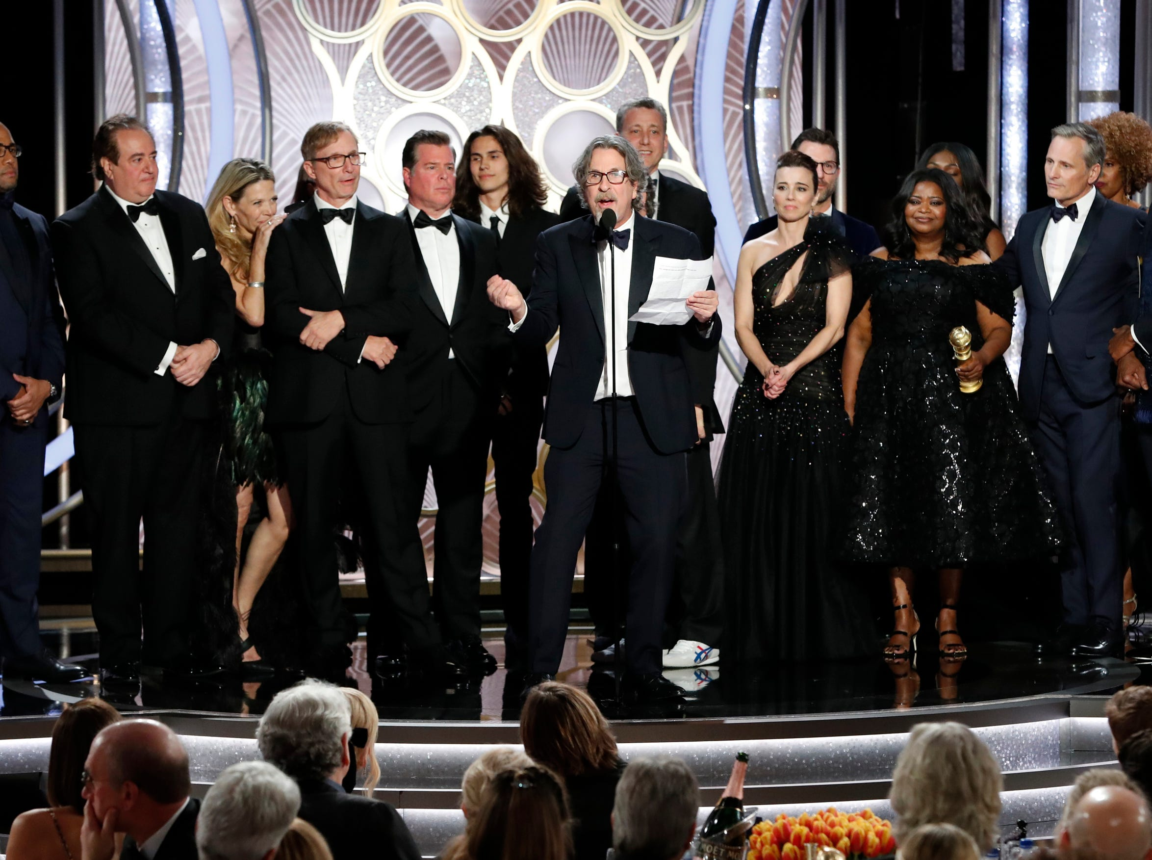 "This image released by NBC shows Peter Farrelly, foreground, accepting the award for best comedy film for ""Green Book"" during the 76th Annual Golden Globe Awards."