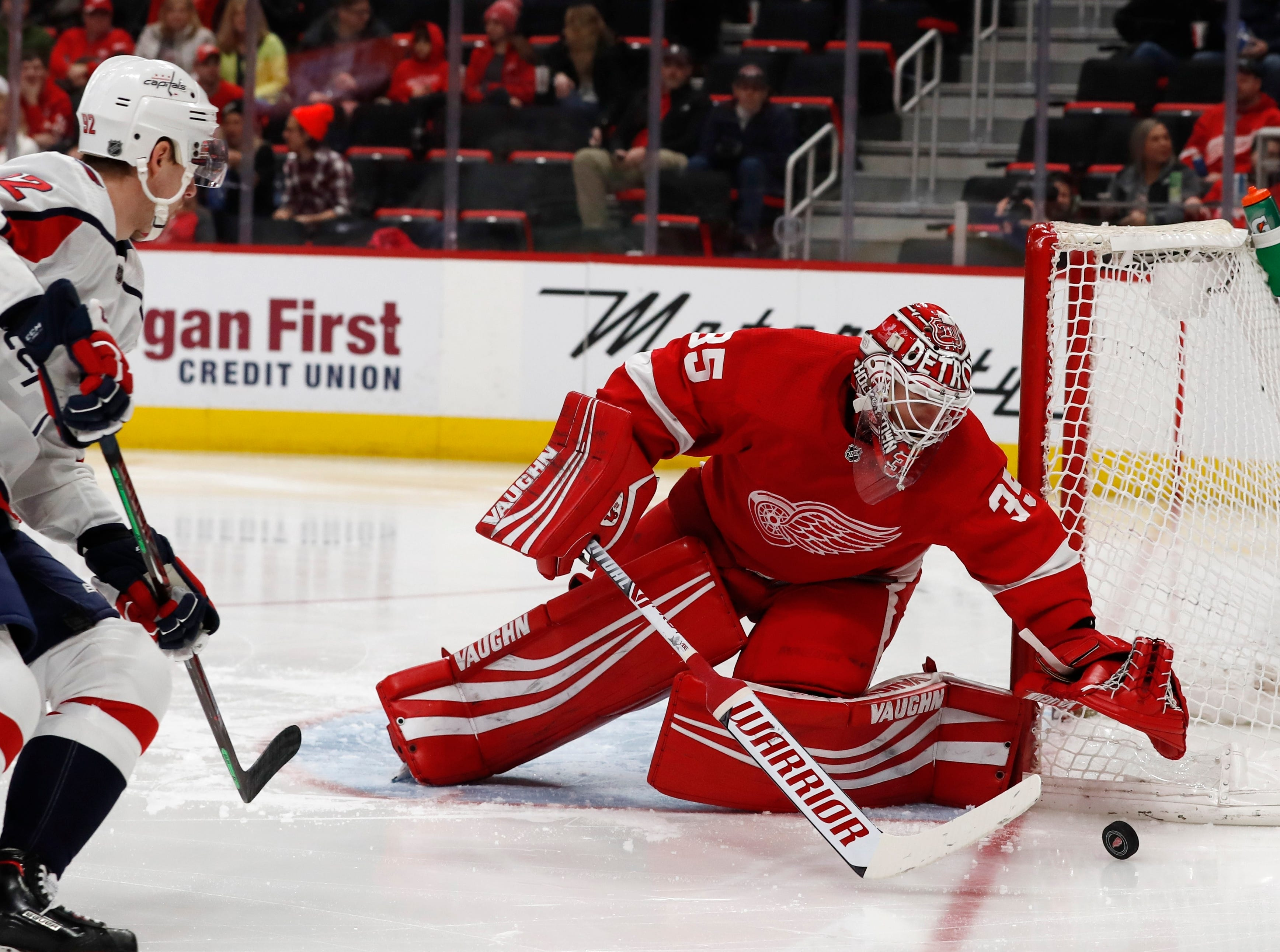 Detroit Red Wings goaltender Jimmy Howard (35) reaches for the puck as Washington Capitals center Evgeny Kuznetsov (92) approaches during the second period.