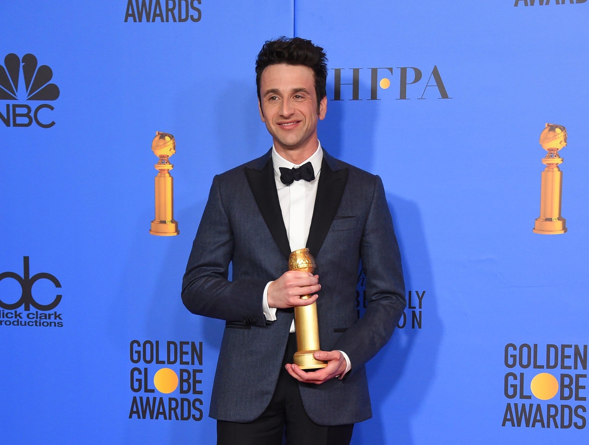 "Justin Hurwitz poses in the press room with the award for best original score, motion picture for ""First Man"" at the 76th annual Golden Globe Awards at the Beverly Hilton Hotel."