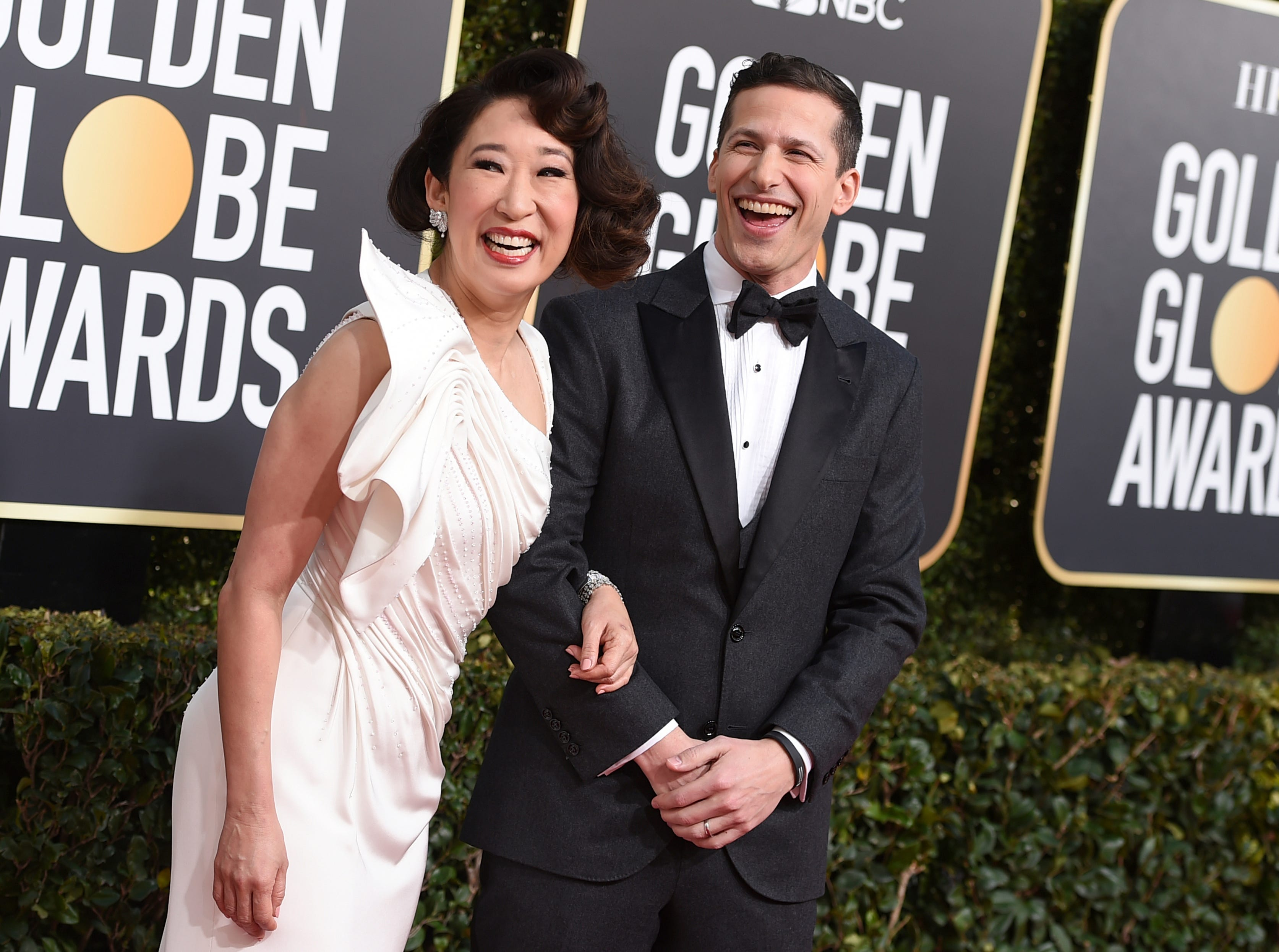 Hosts Sandra Oh, left, and Andy Samberg arrive at the 76th annual Golden Globe Awards at the Beverly Hilton Hotel on Sunday, Jan. 6, 2019, in Beverly Hills, Calif.