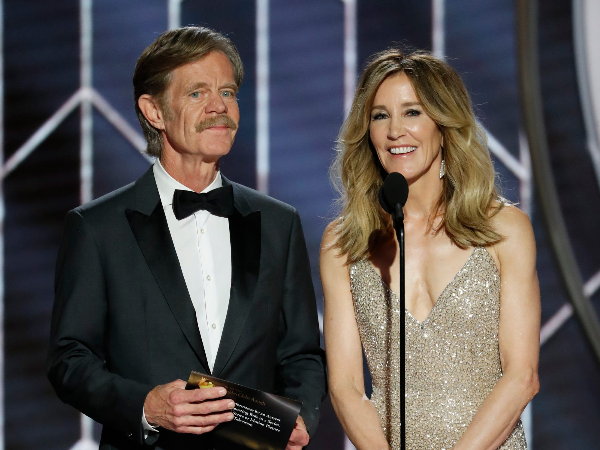 This image released by NBC shows presenters William H. Macy, left, and Felicity Huffman during the 76th Annual Golden Globe Awards at the Beverly Hilton Hotel.
