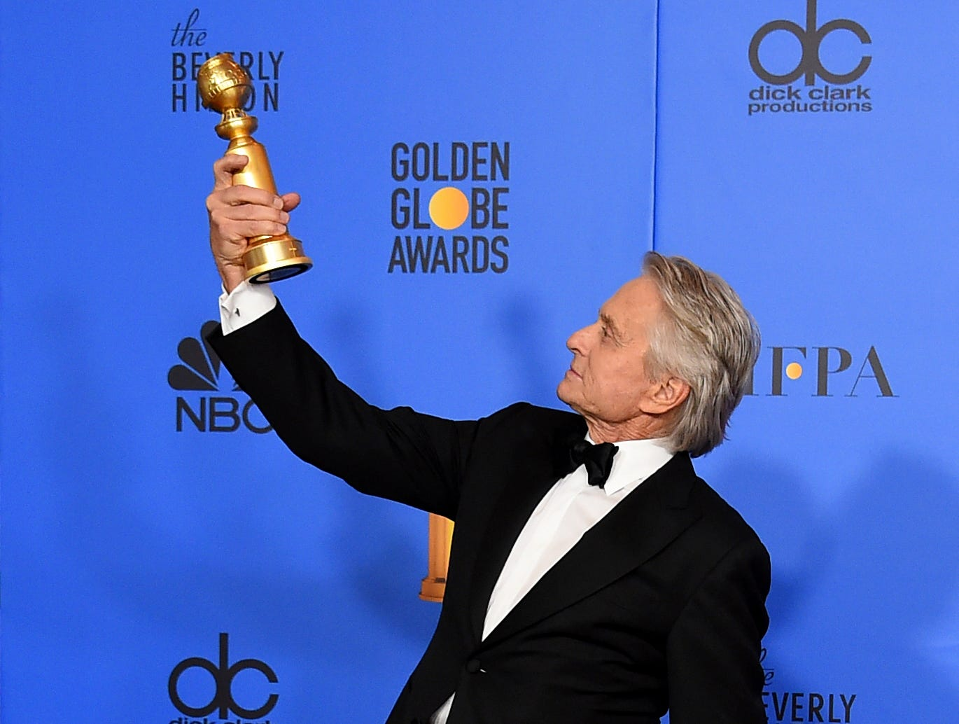 "Michael Douglas poses in the press room with the award for best performance by an actor in a television series, musical or comedy for ""The Kominsky Method"" at the 76th annual Golden Globe Awards at the Beverly Hilton Hotel."