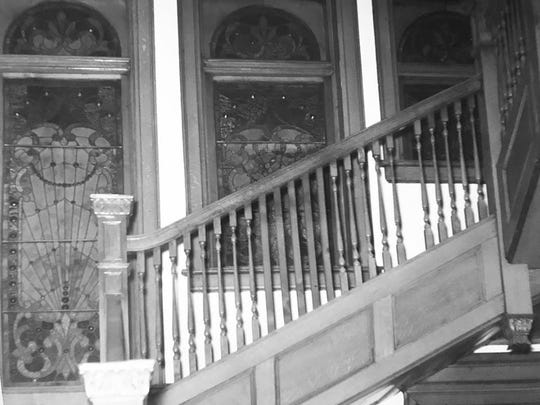 A vintage photo shows the stained glass windows originally in place in the David Mackenzie house, built in 1895.