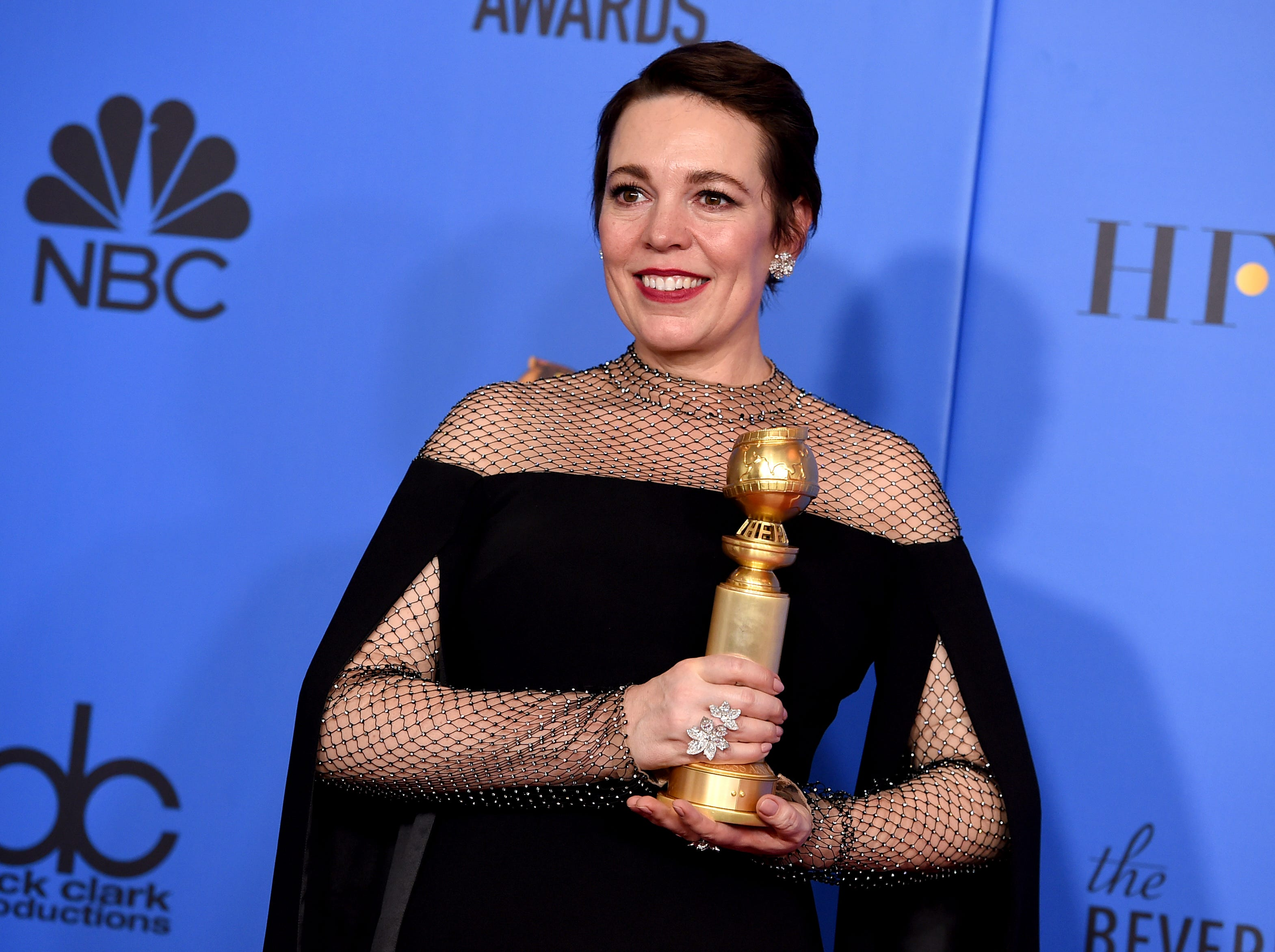 "Olivia Colman poses in the press room with the award for best performance by an actress in a motion picture, musical or comedy for ""The Favourite"" at the 76th annual Golden Globe Awards."