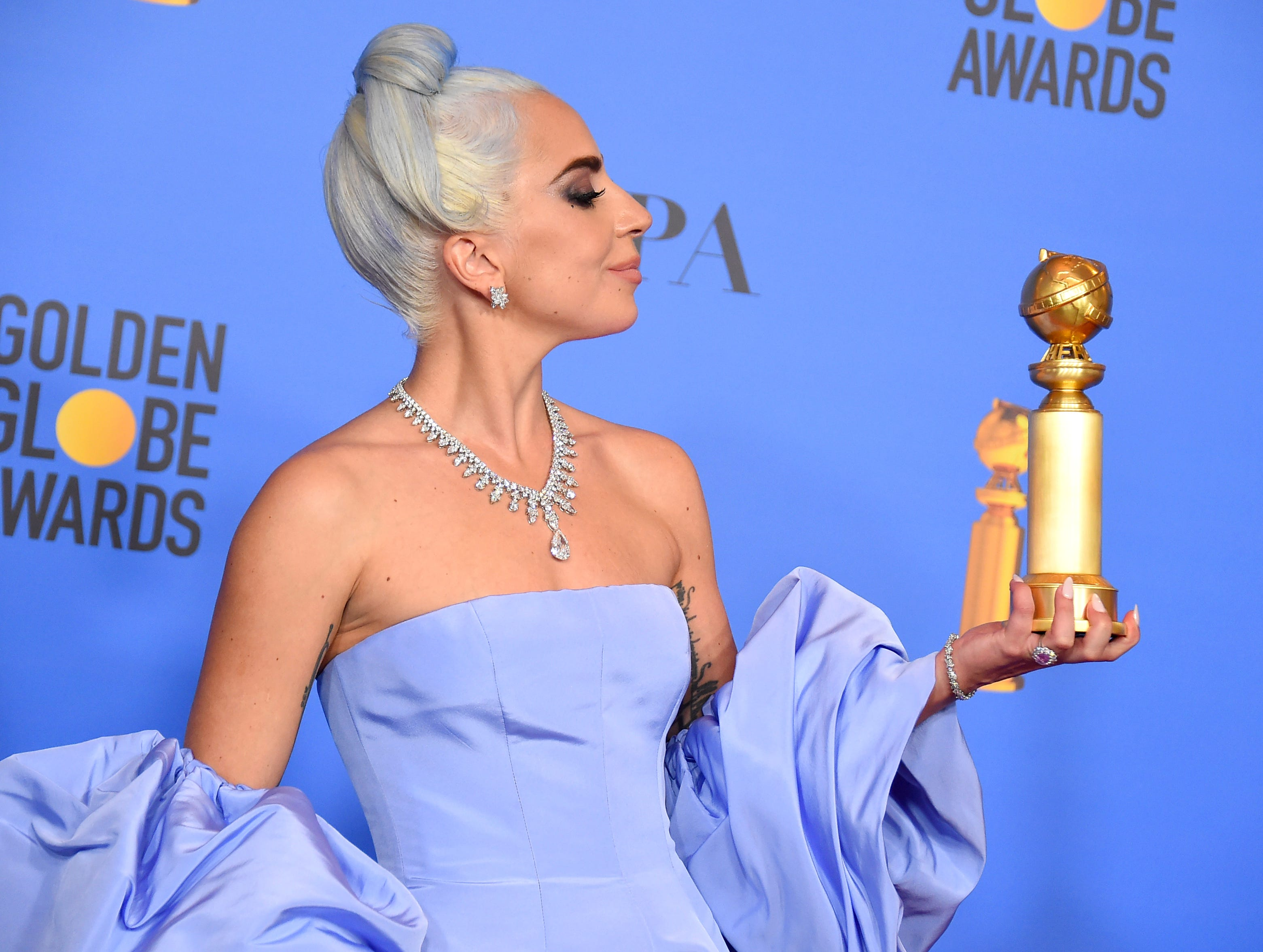 "Lady Gaga poses in the press room with the award for best original song, motion picture for ""Shallow"" from the film ""A Star Is Born"" at the 76th annual Golden Globe Awards at the Beverly Hilton Hotel."