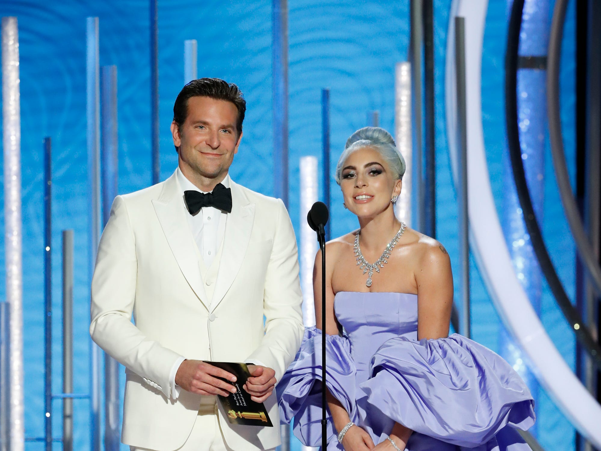 This image released by NBC shows Bradley Cooper, left, and Lady Gaga presenting the award for best actor in a TV comedy series at the 76th Annual Golden Globe Awards at the Beverly Hilton Hotel.